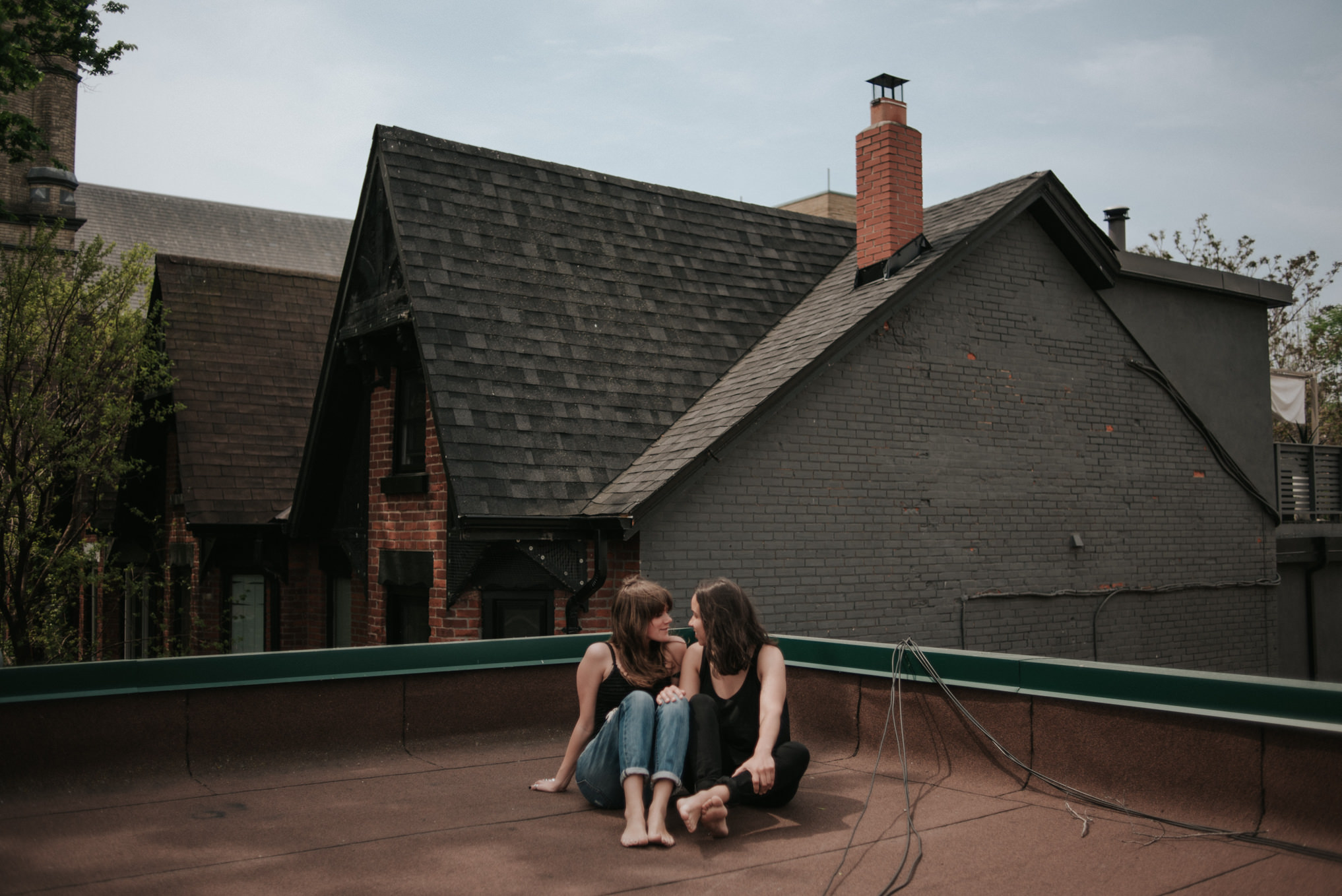An intimate rooftop femme engagement shoot by Daring Wanderer // www.daringwanderer.com