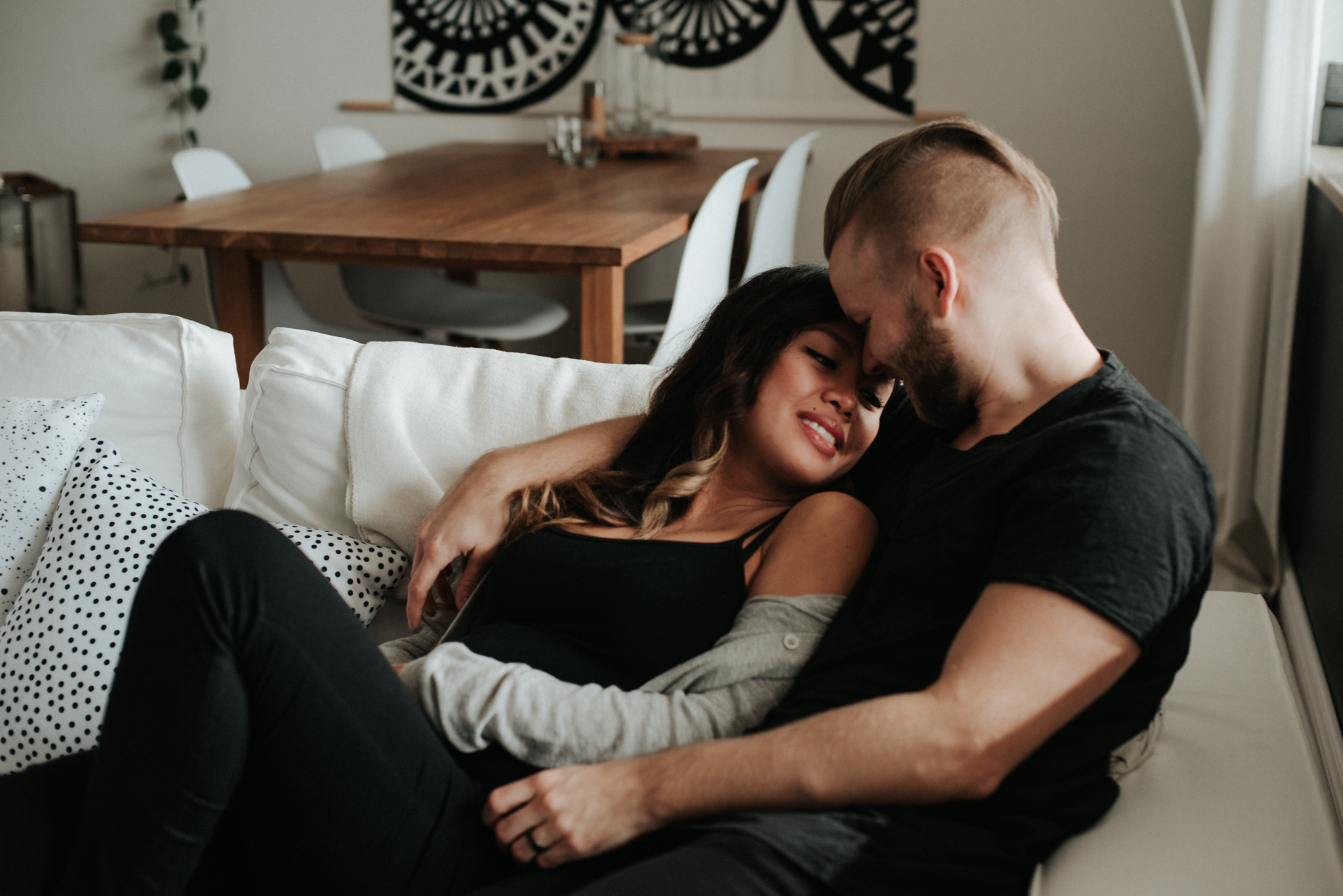A cozy in home maternity shoot with a gorgeous couple in their beautifully styled Toronto condo // Photographed by Toronto Wedding Photographer Daring Wanderer