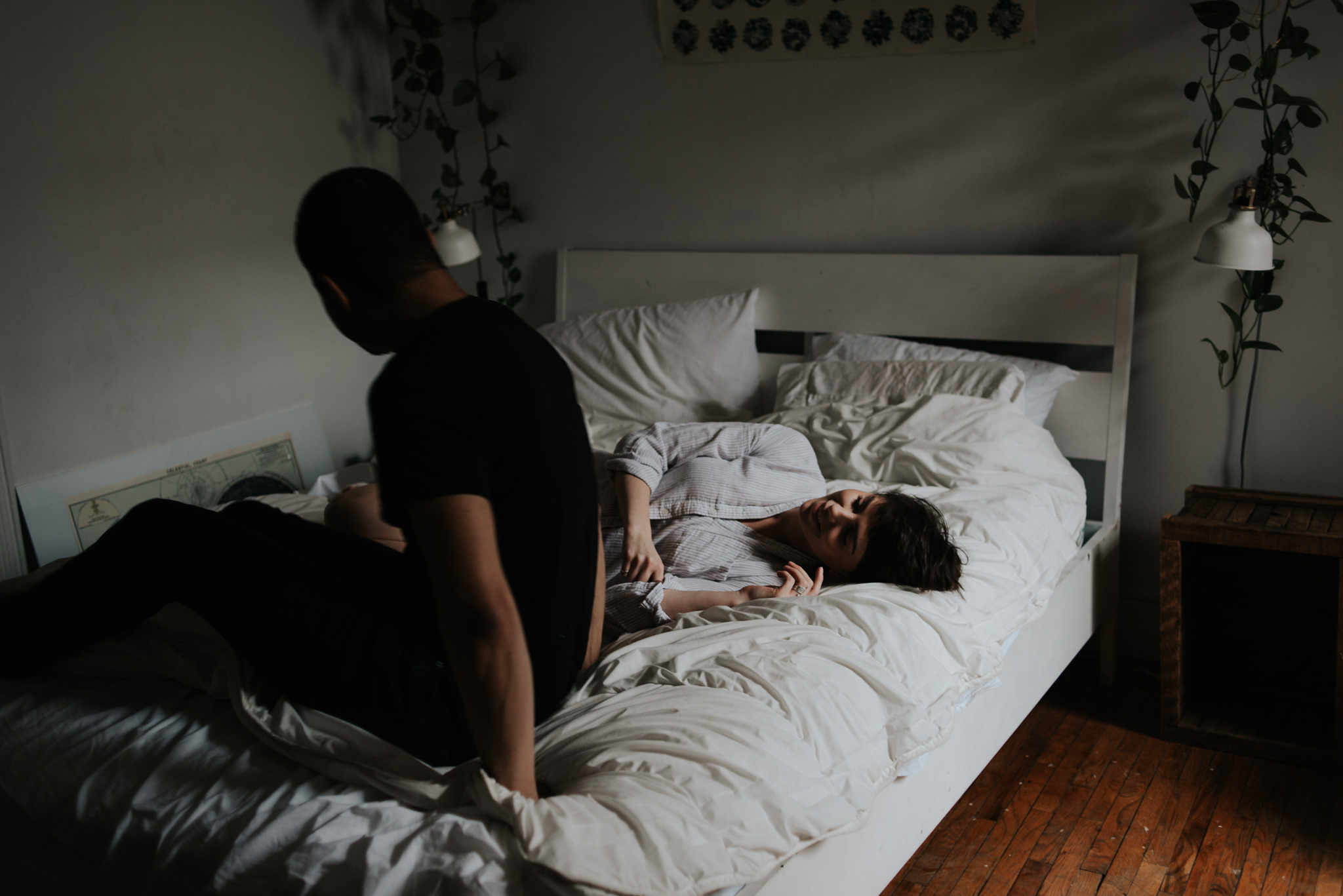 Young lovers lying in bed in bohemian apartment // Downtown Toronto Couple Shoot by Daring Wanderer