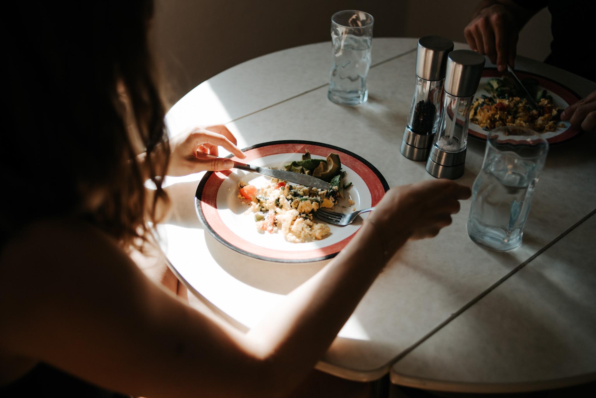 Omelet breakfast on plate in sunlight