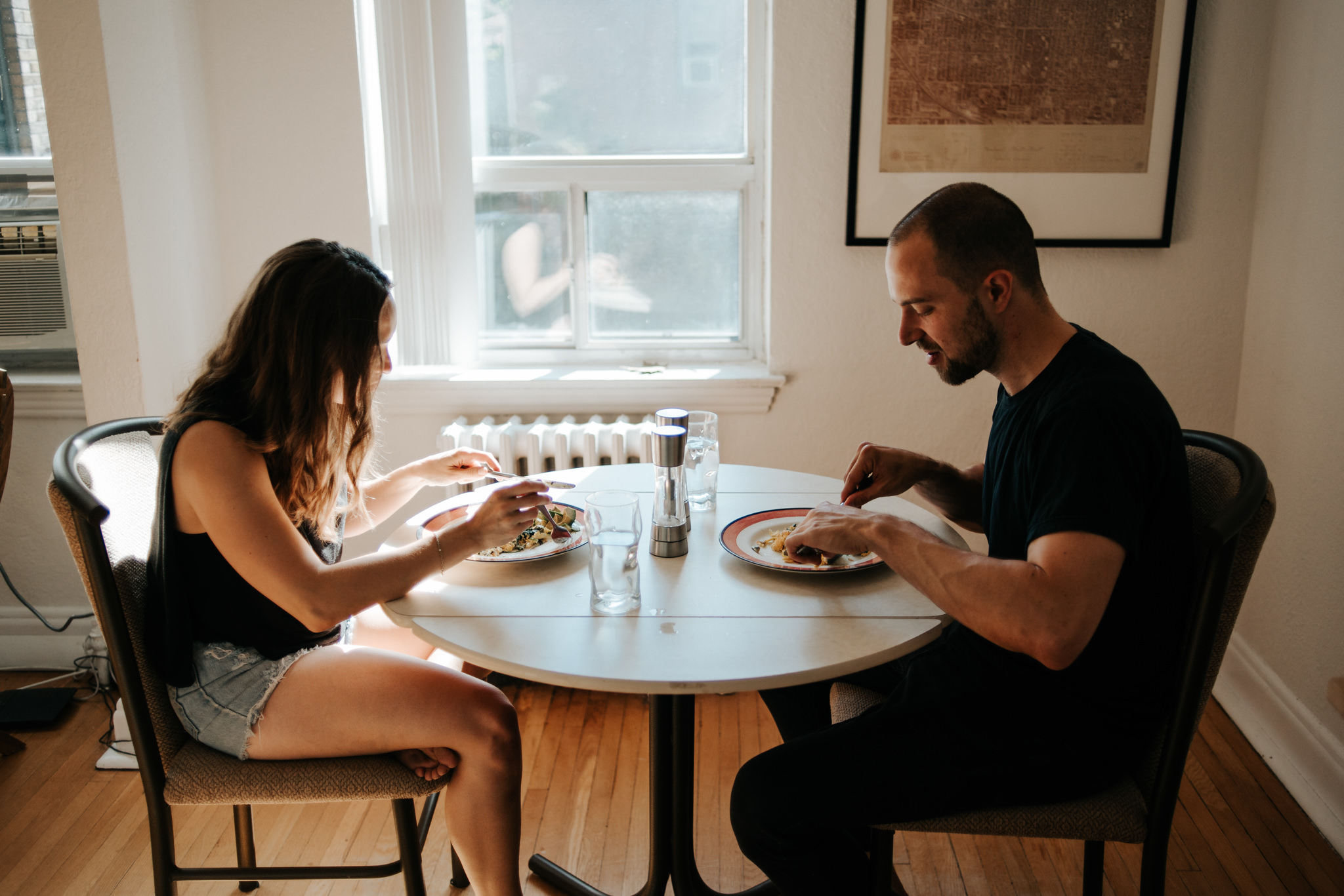 Couple eating breakfast in apartment
