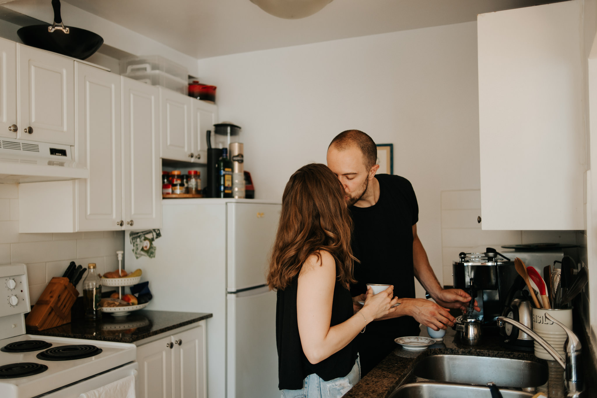 Couple kissing in apartment kitchen
