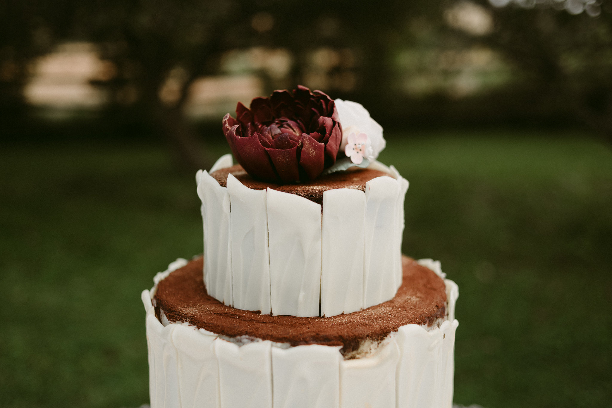 Homemade chocolate wedding cake topped with flowers