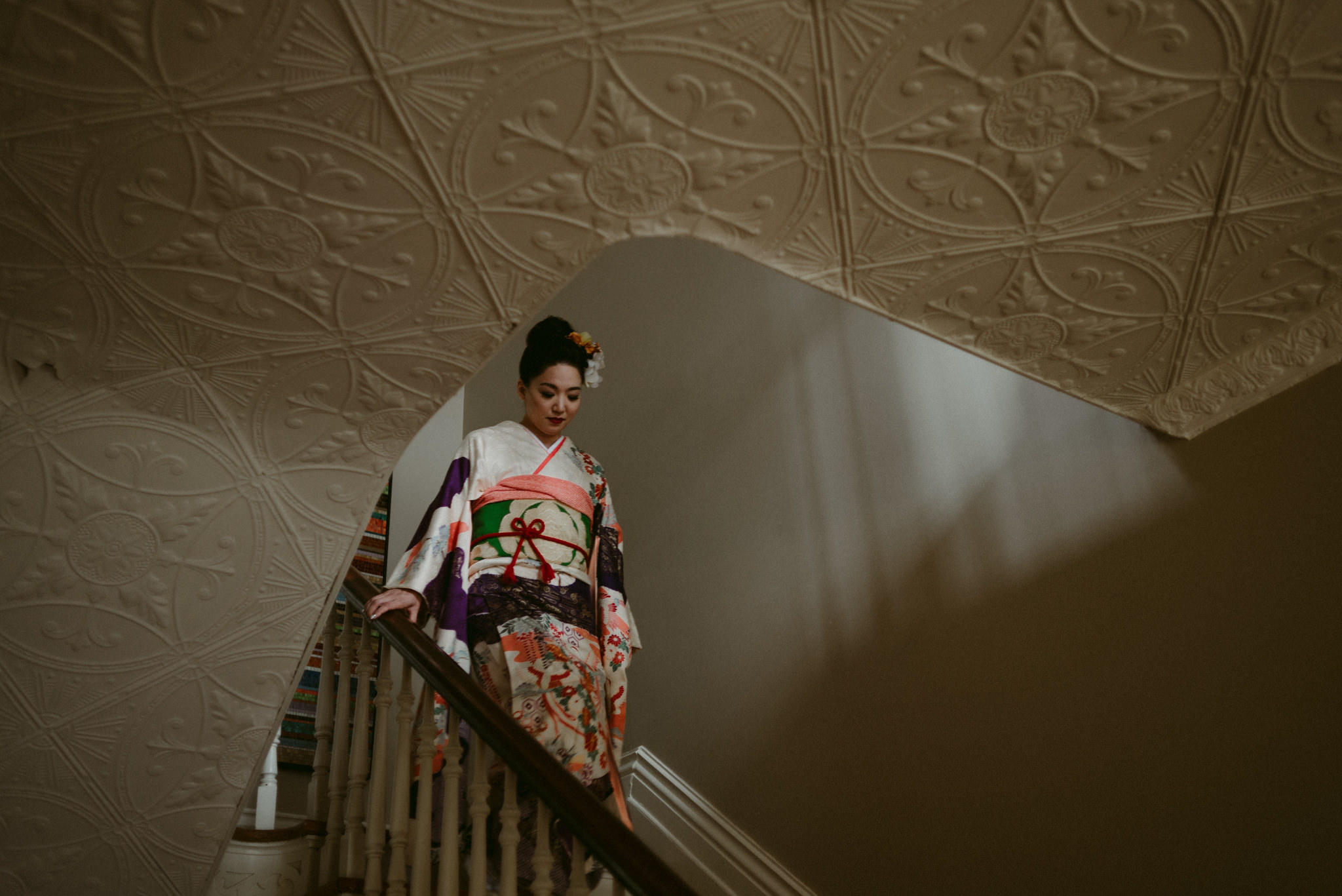 Japanese women in kimono walking down stairs