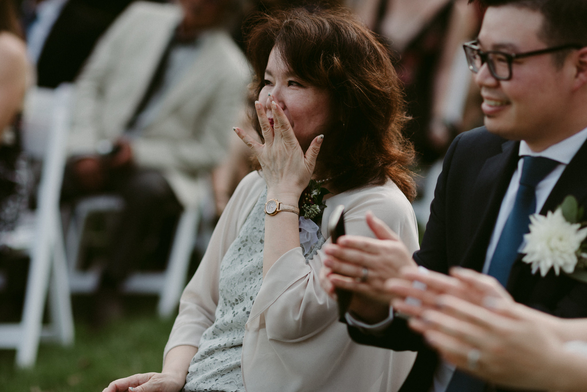Emotional mother of bride during ceremony
