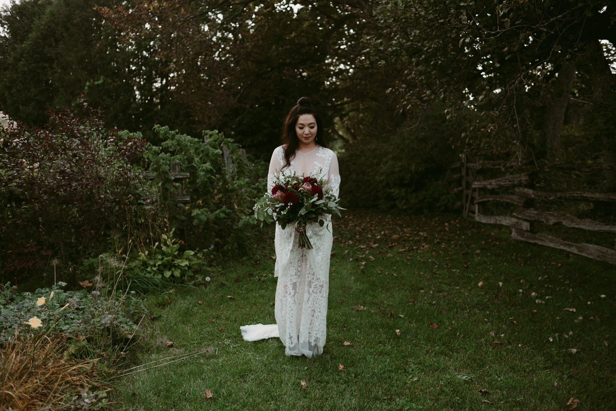 bride in garden holding bouquet