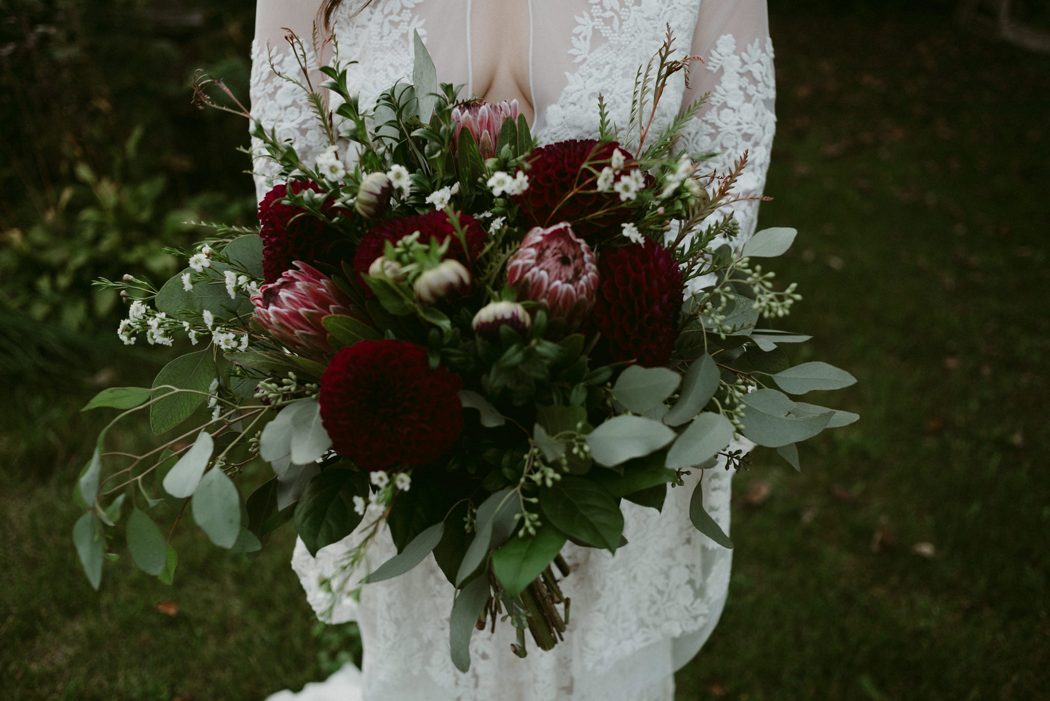 closeup of moody maroon and dark red wedding bouquet