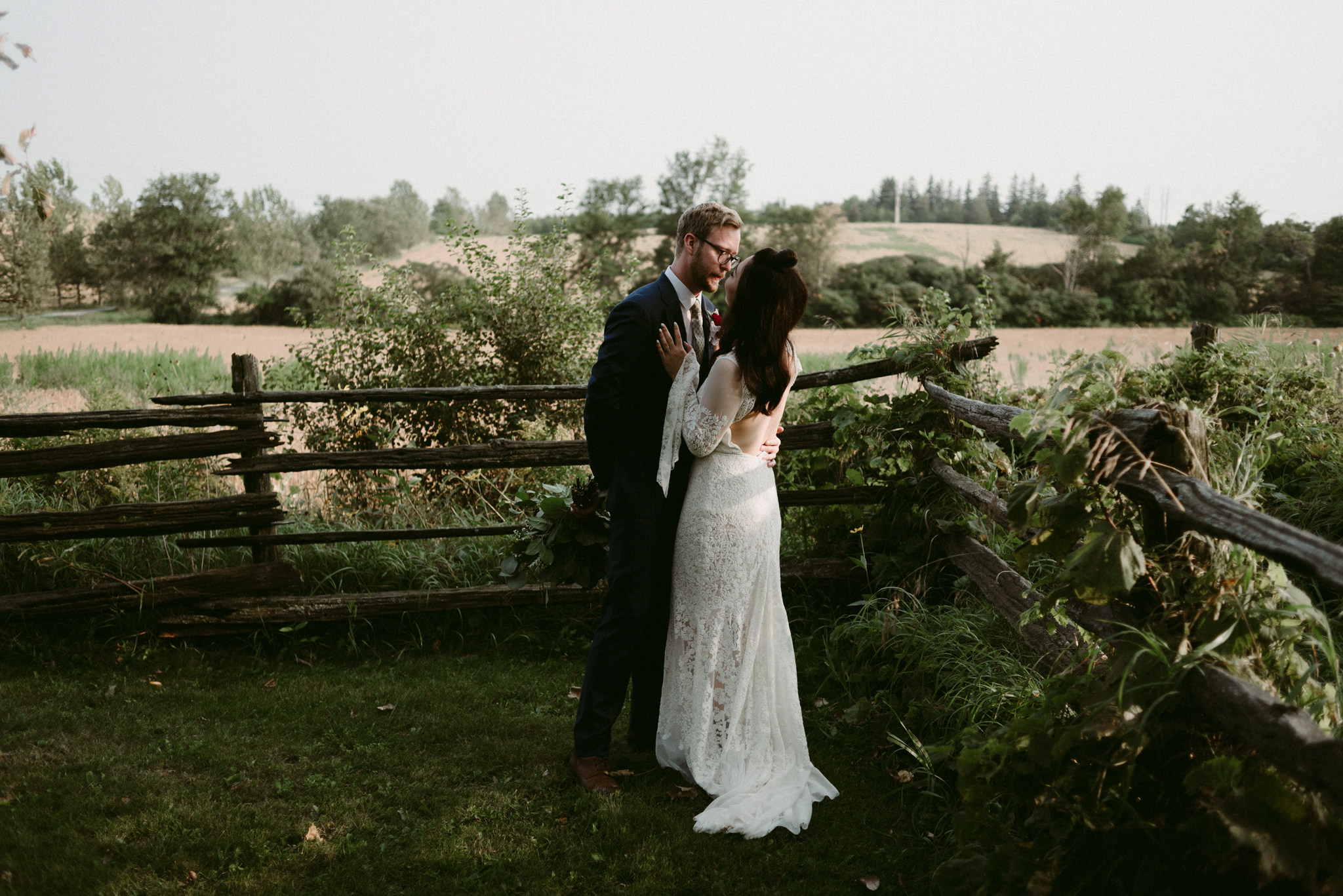 bride and groom hugging outside on farm