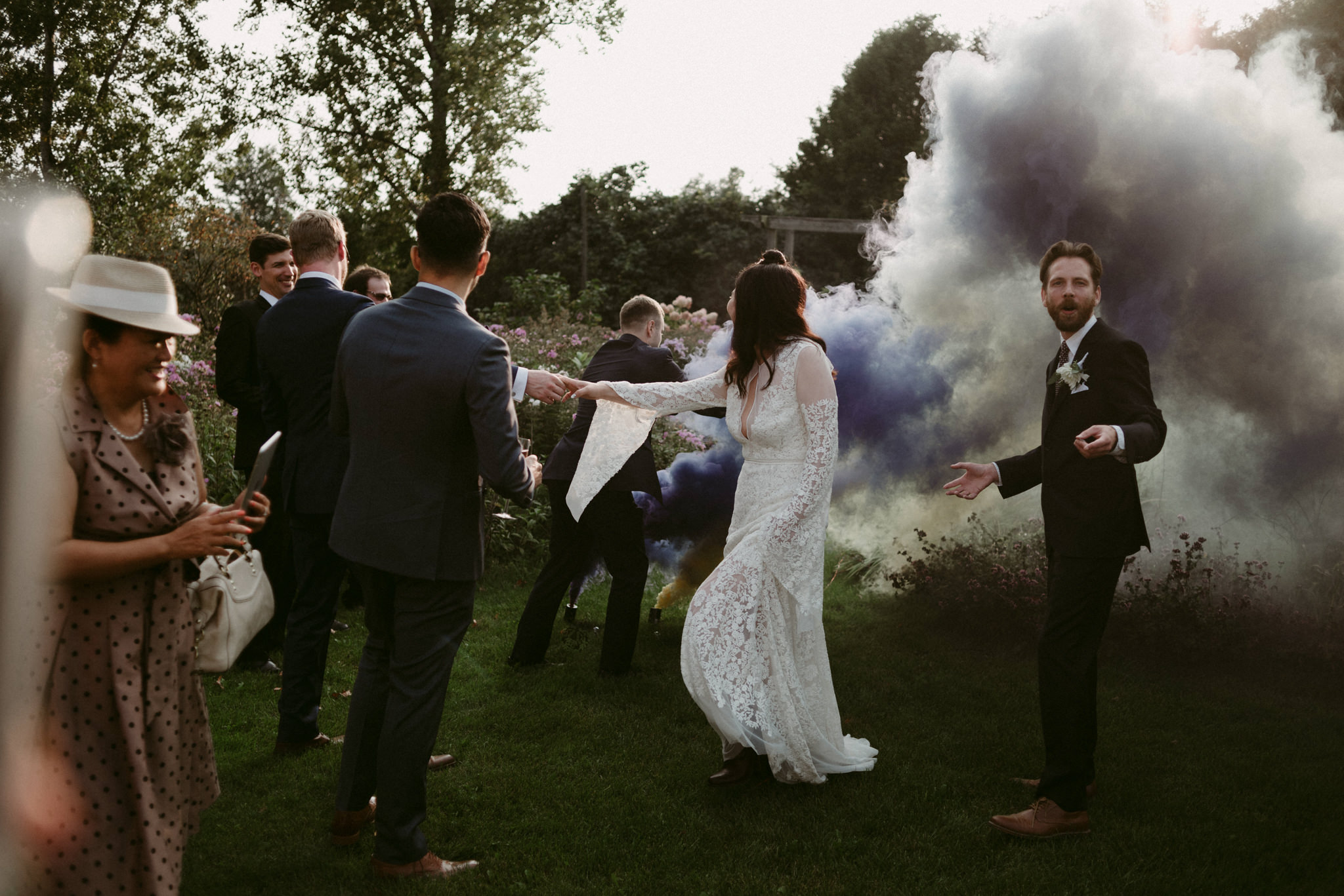 wedding guests running through smoke bombs