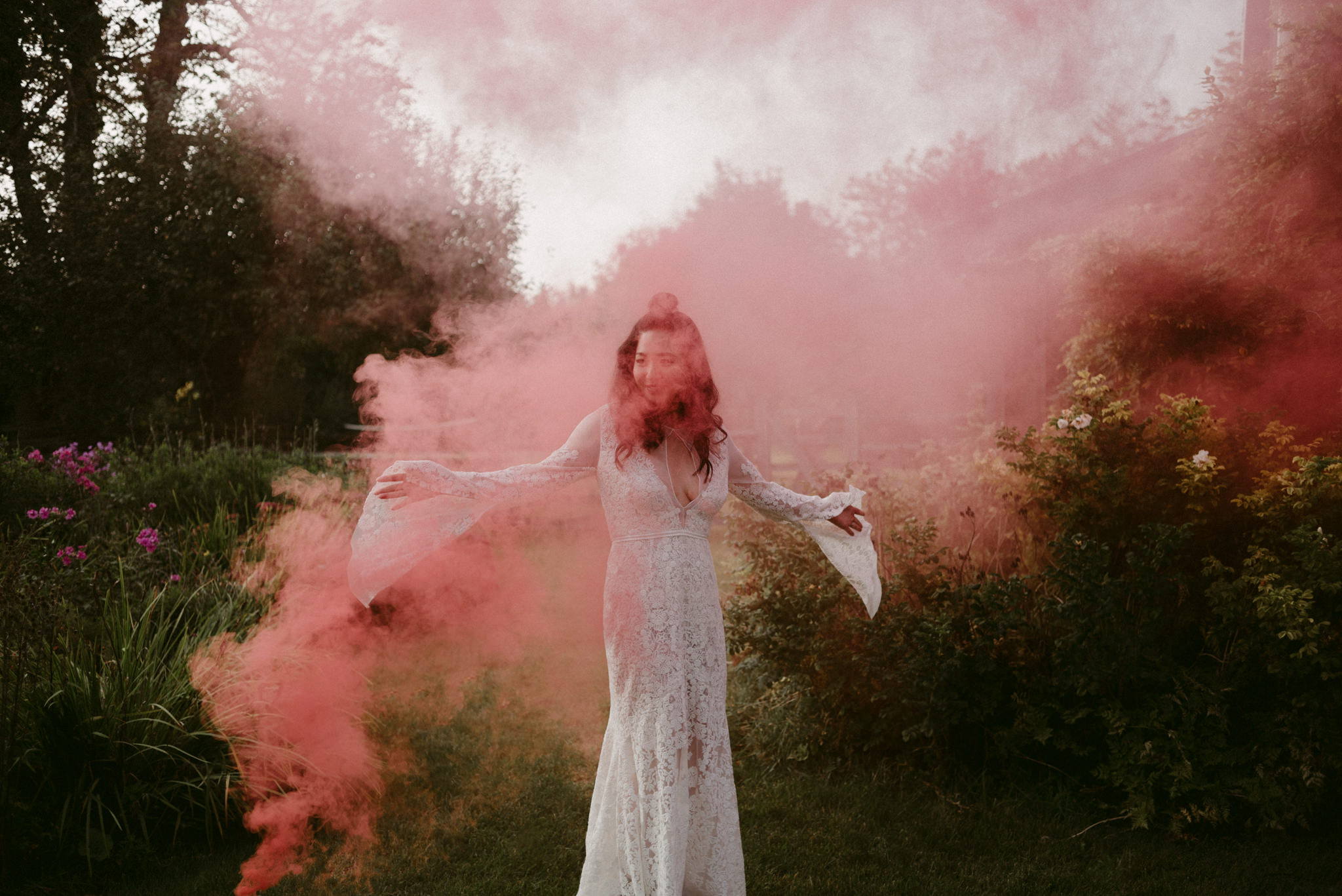 bride dancing in red smoke bomb