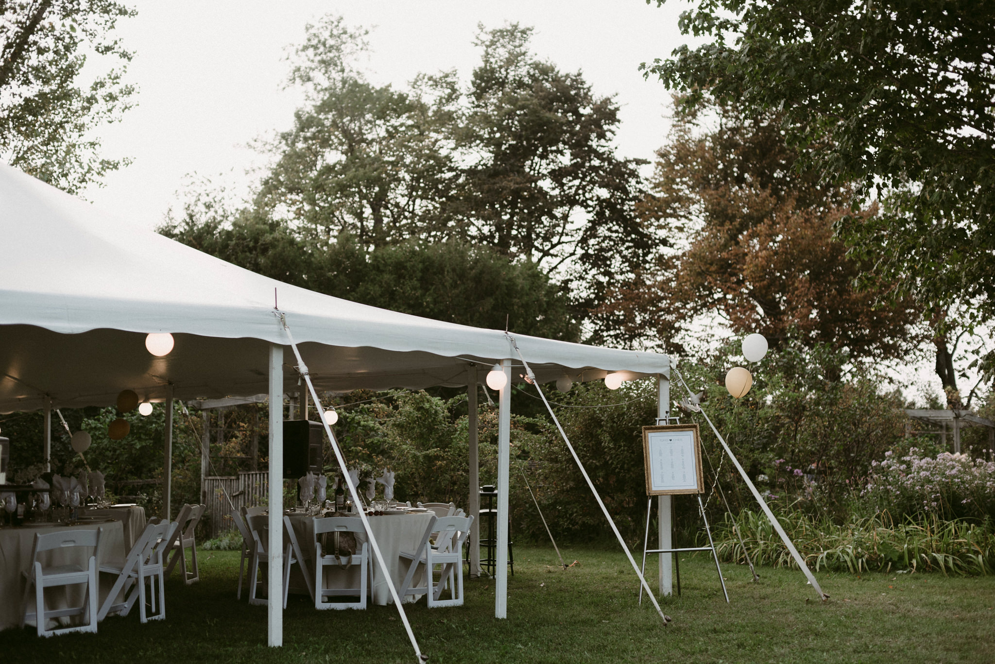 Tented backyard wedding reception