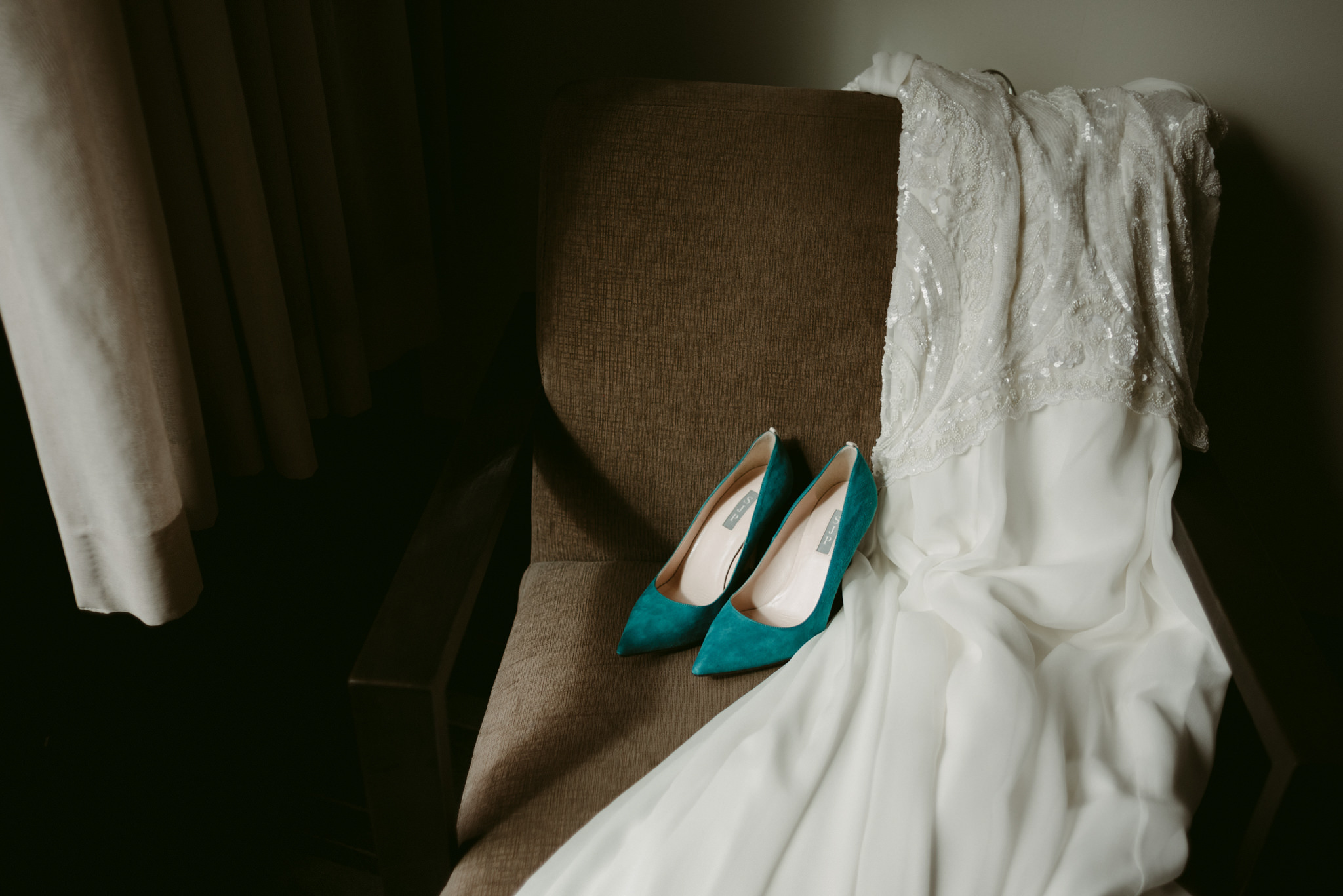 Wedding dress and shoes on chair