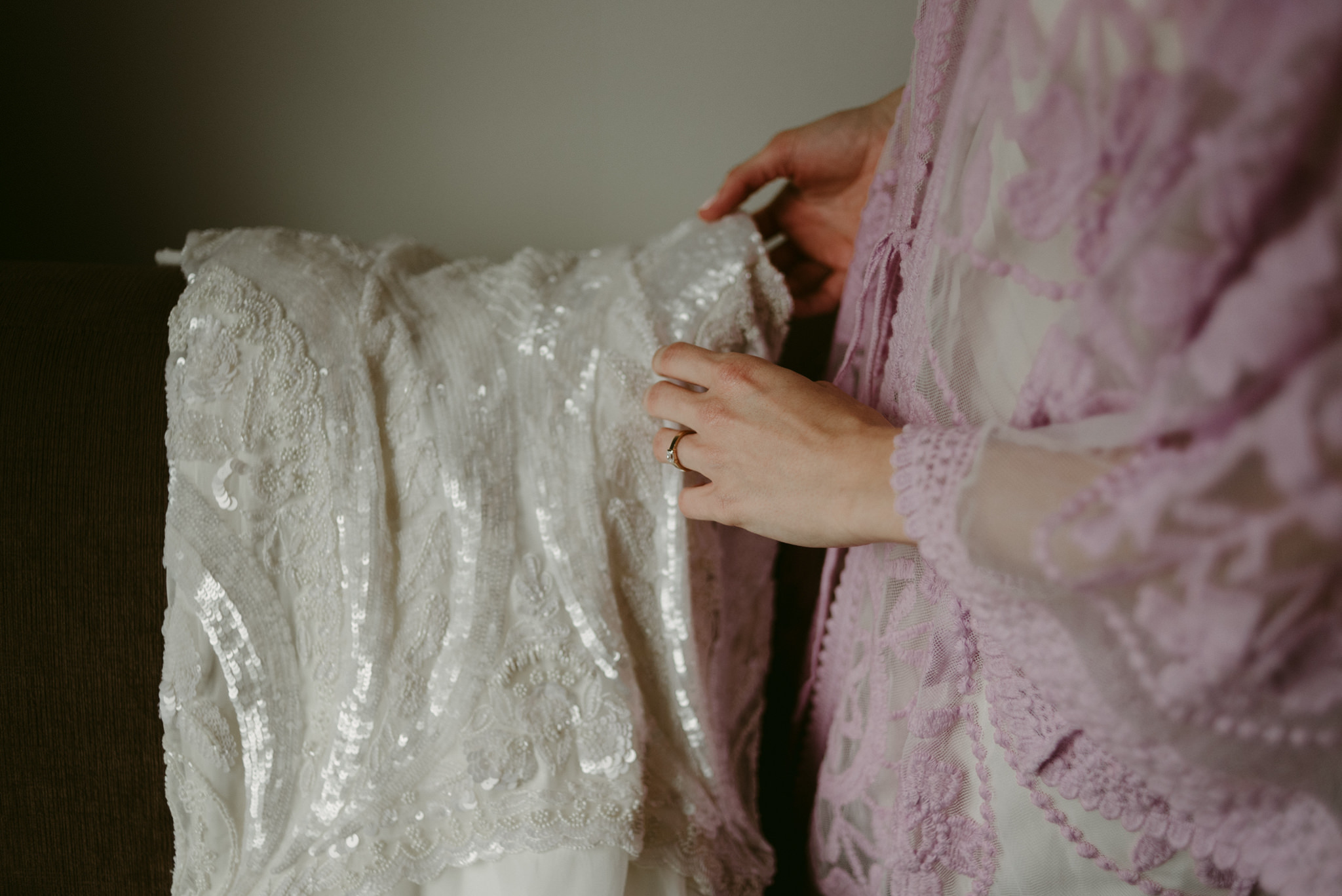 Bride touching wedding dress