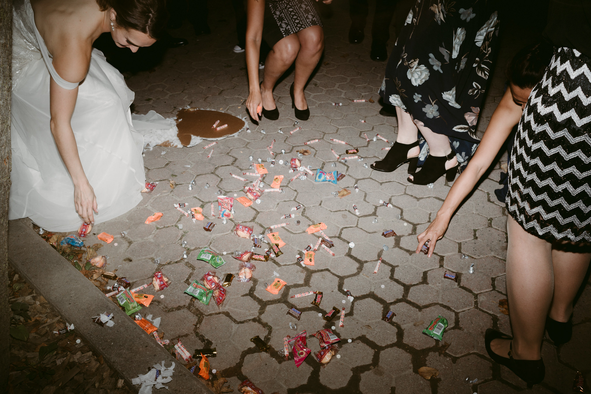 Candy from piñata on ground at wedding reception