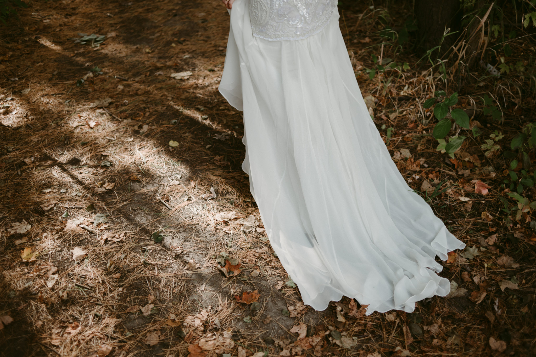 Wedding dress on forest floor