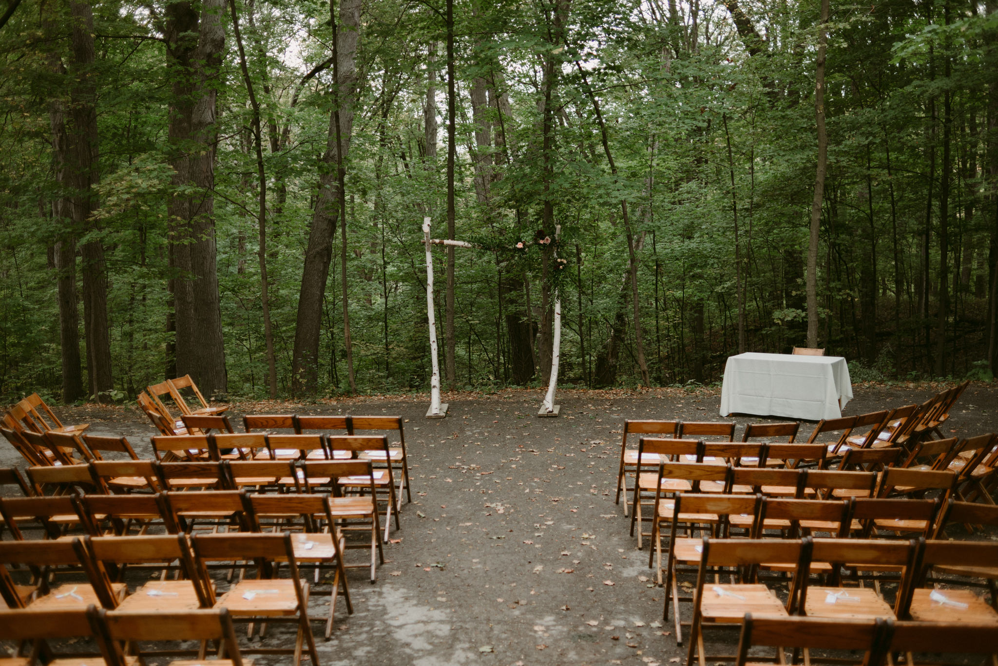 Forest wedding ceremony setup at Kortright Centre for Conservation Wedding