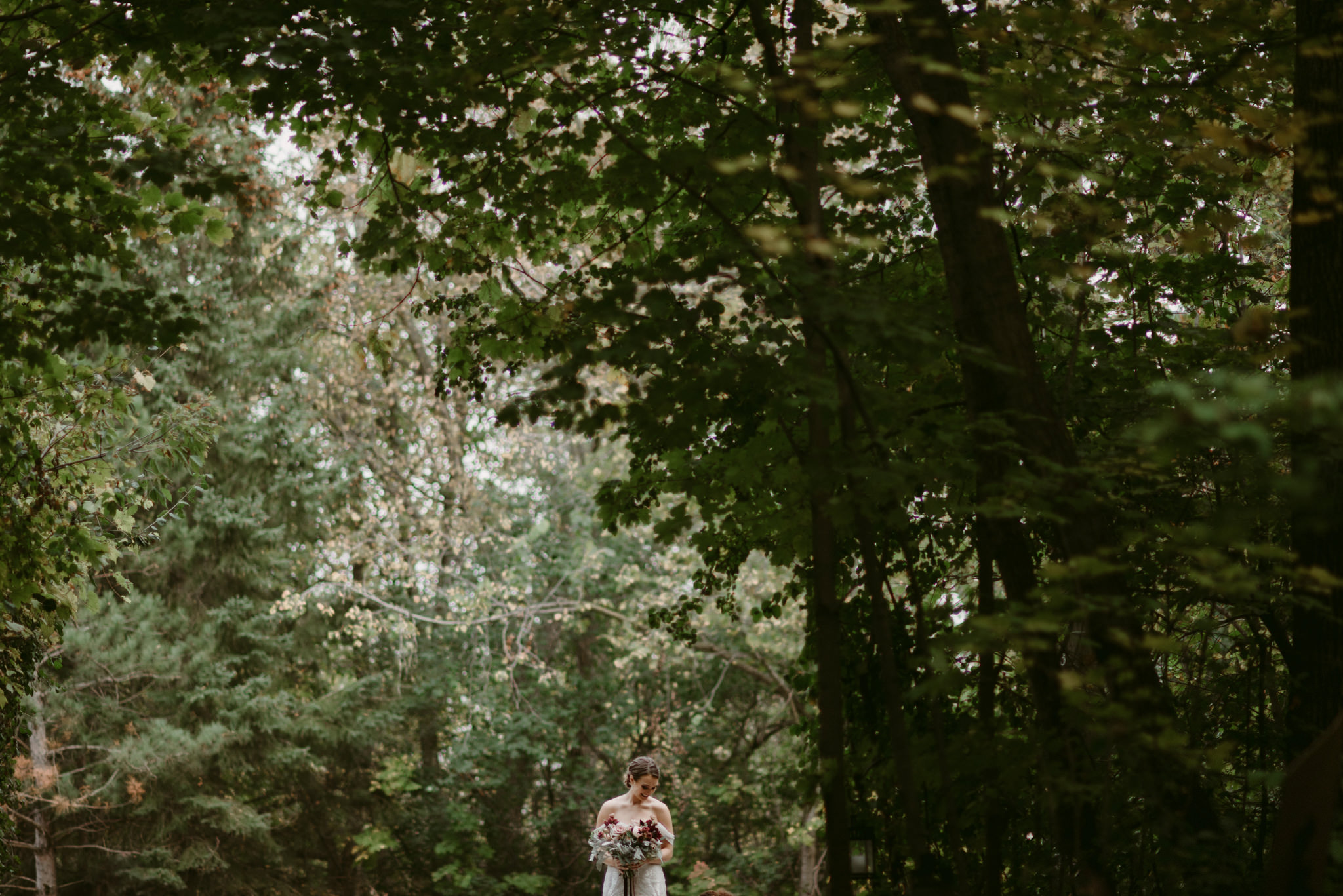 Bride waiting to walk down aisle in forest wedding ceremony