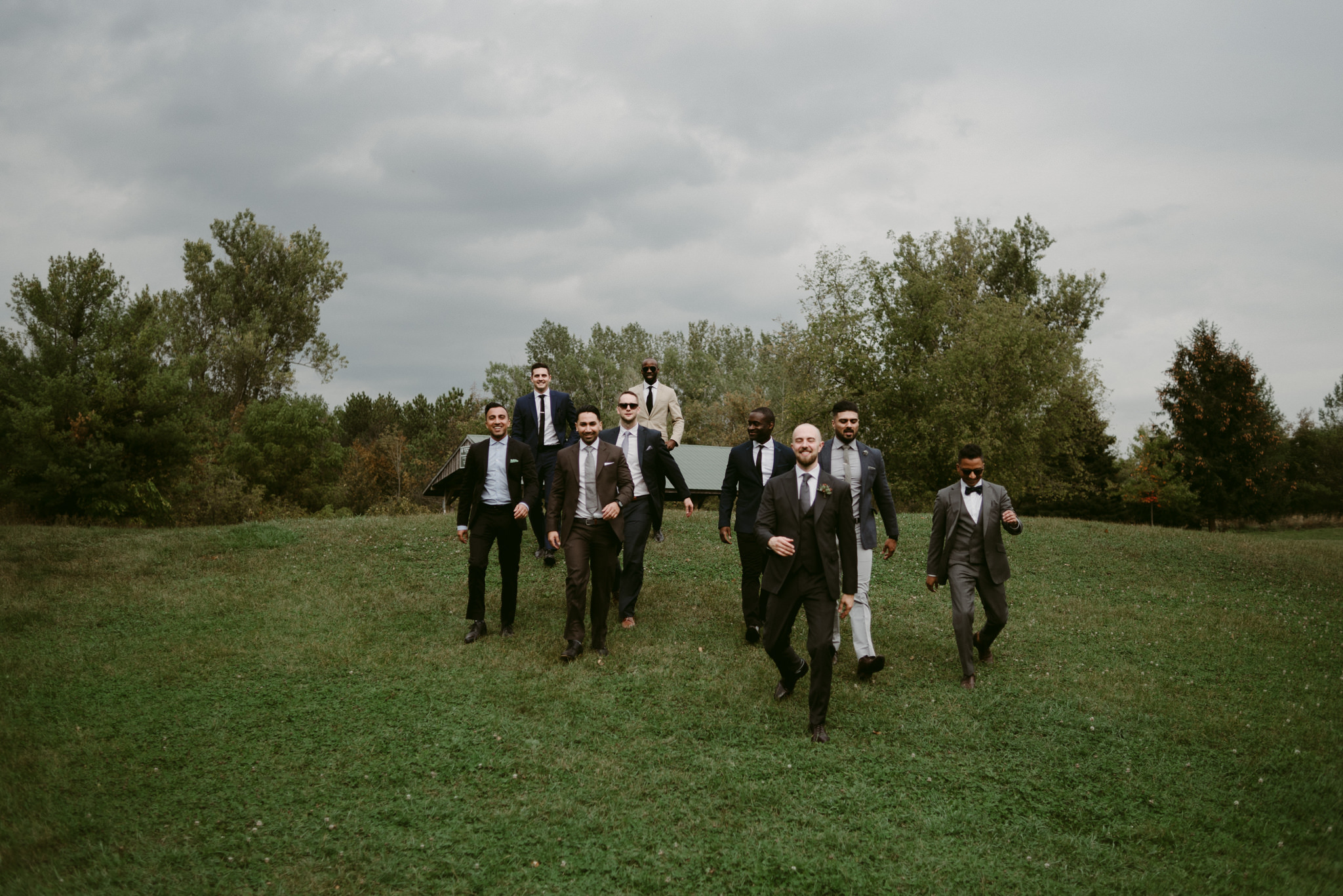 Groomsmen walking down hill