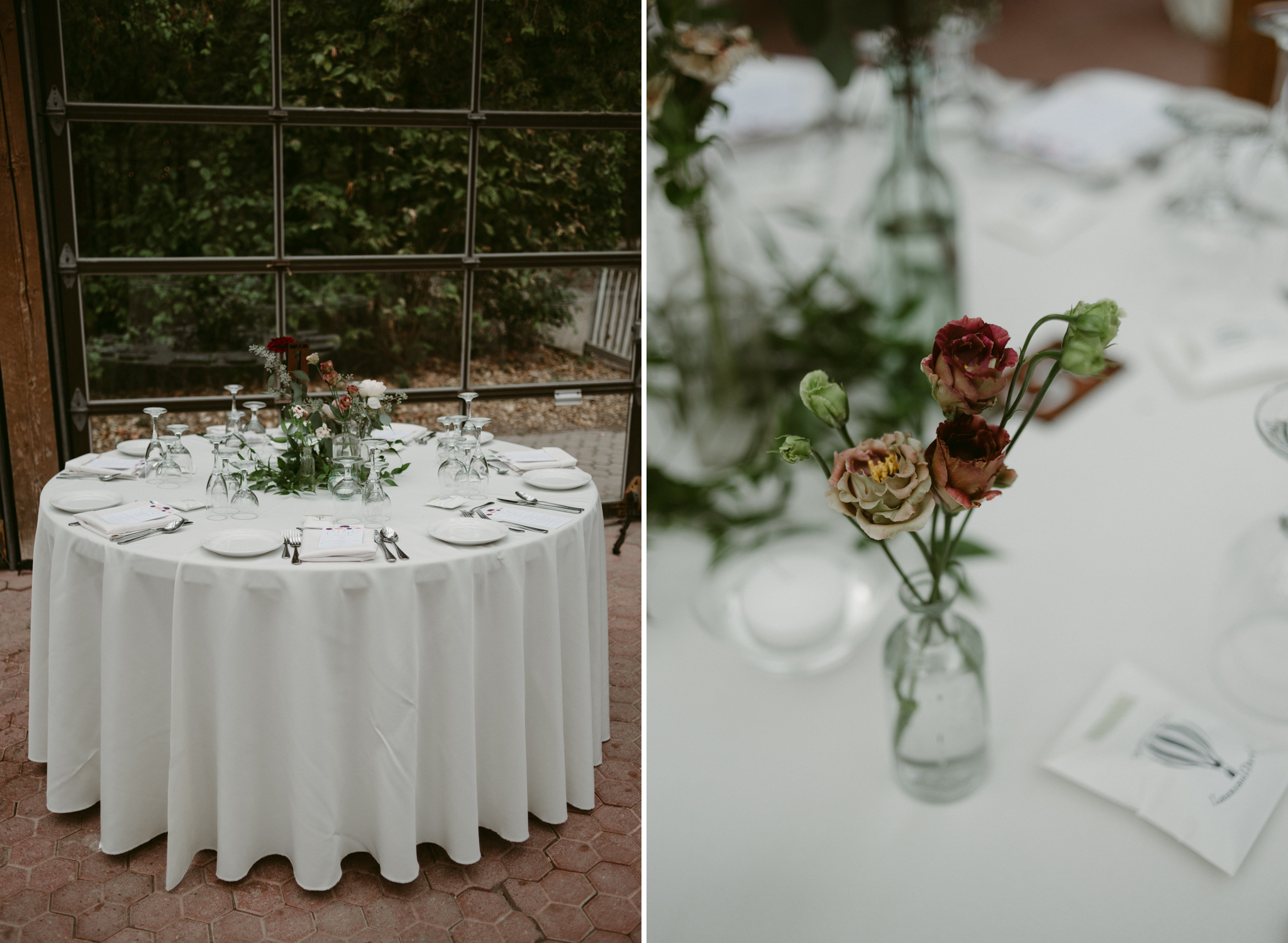 Romantic wedding reception table set up with simple flowers in glass vases