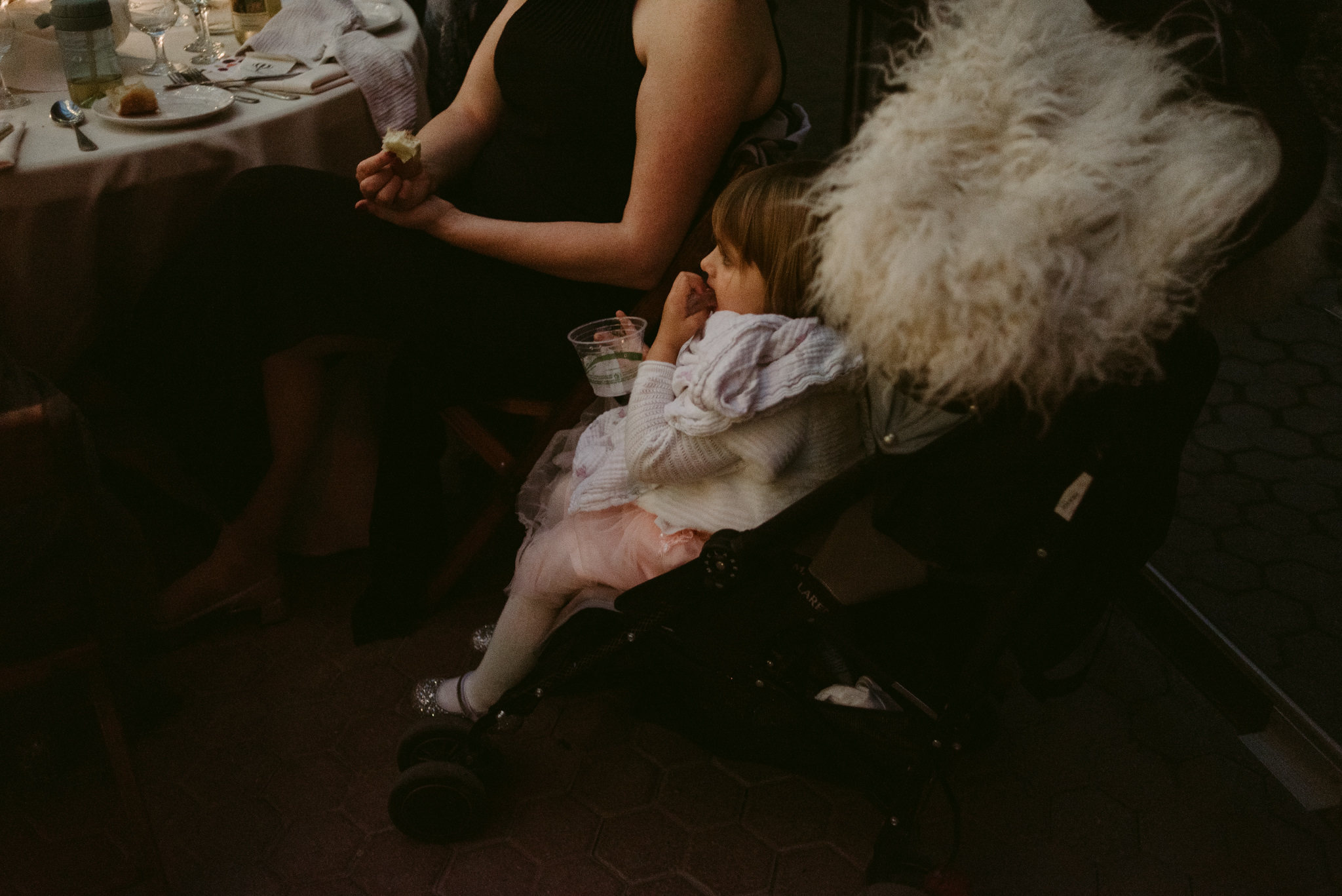 Little girl in stroller at wedding reception