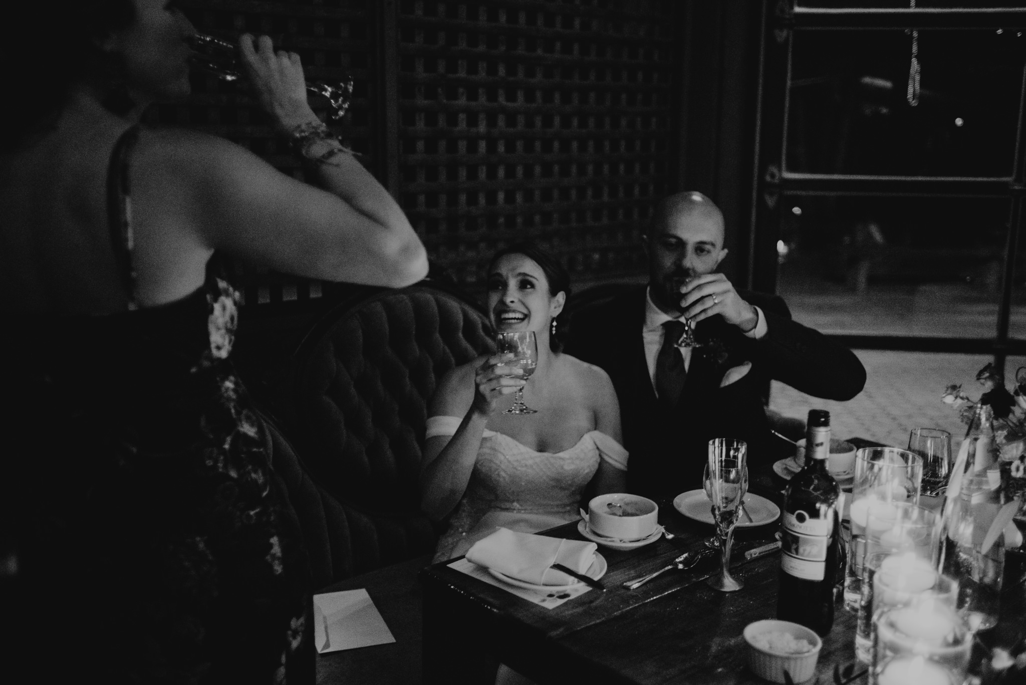 Bride and groom drinking wine during wedding reception