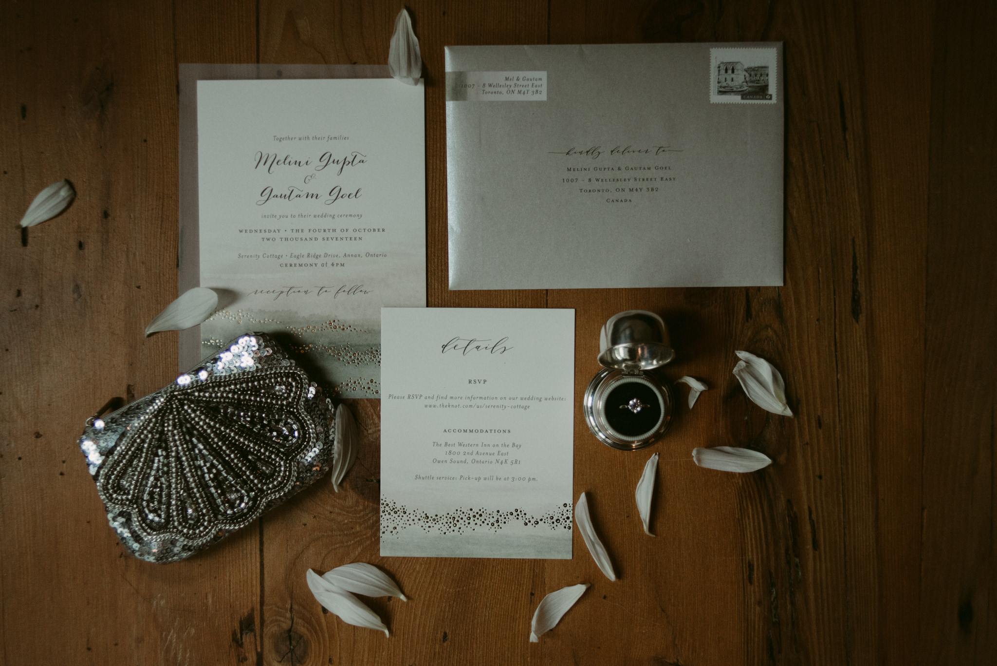 Wedding invitation layout with flowers and sequin purse