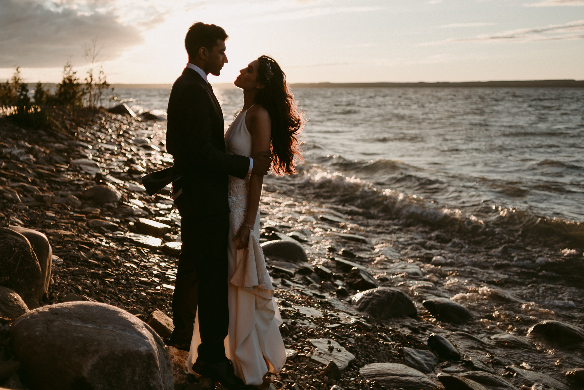 bride and groom by water at sunset on georgian bay