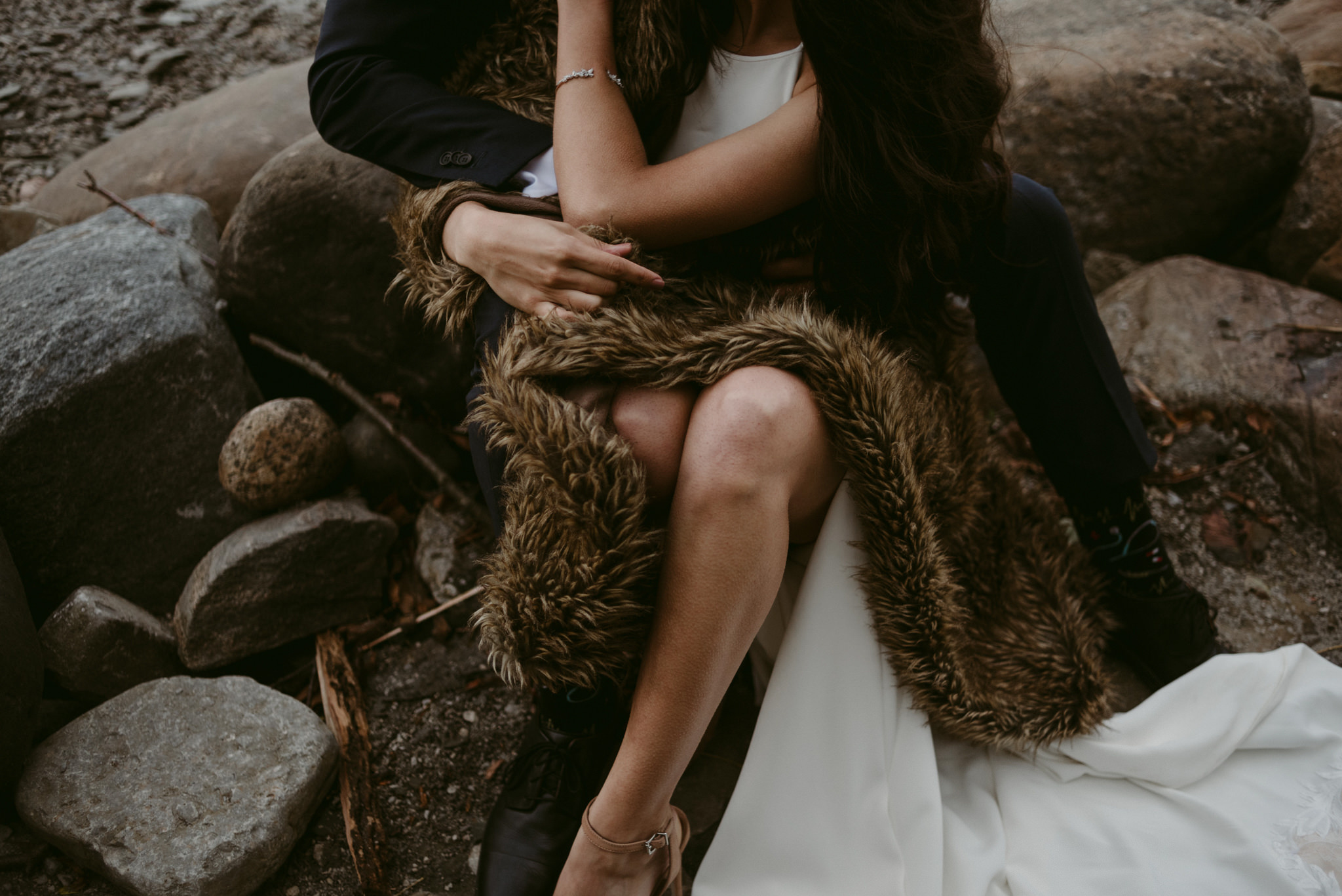 brides legs and fur blanket