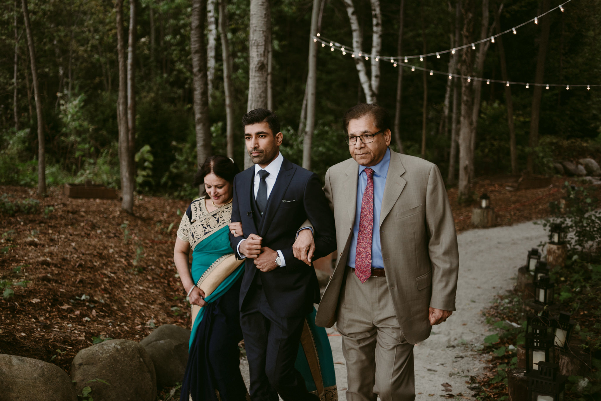 groom walking parents down aisle