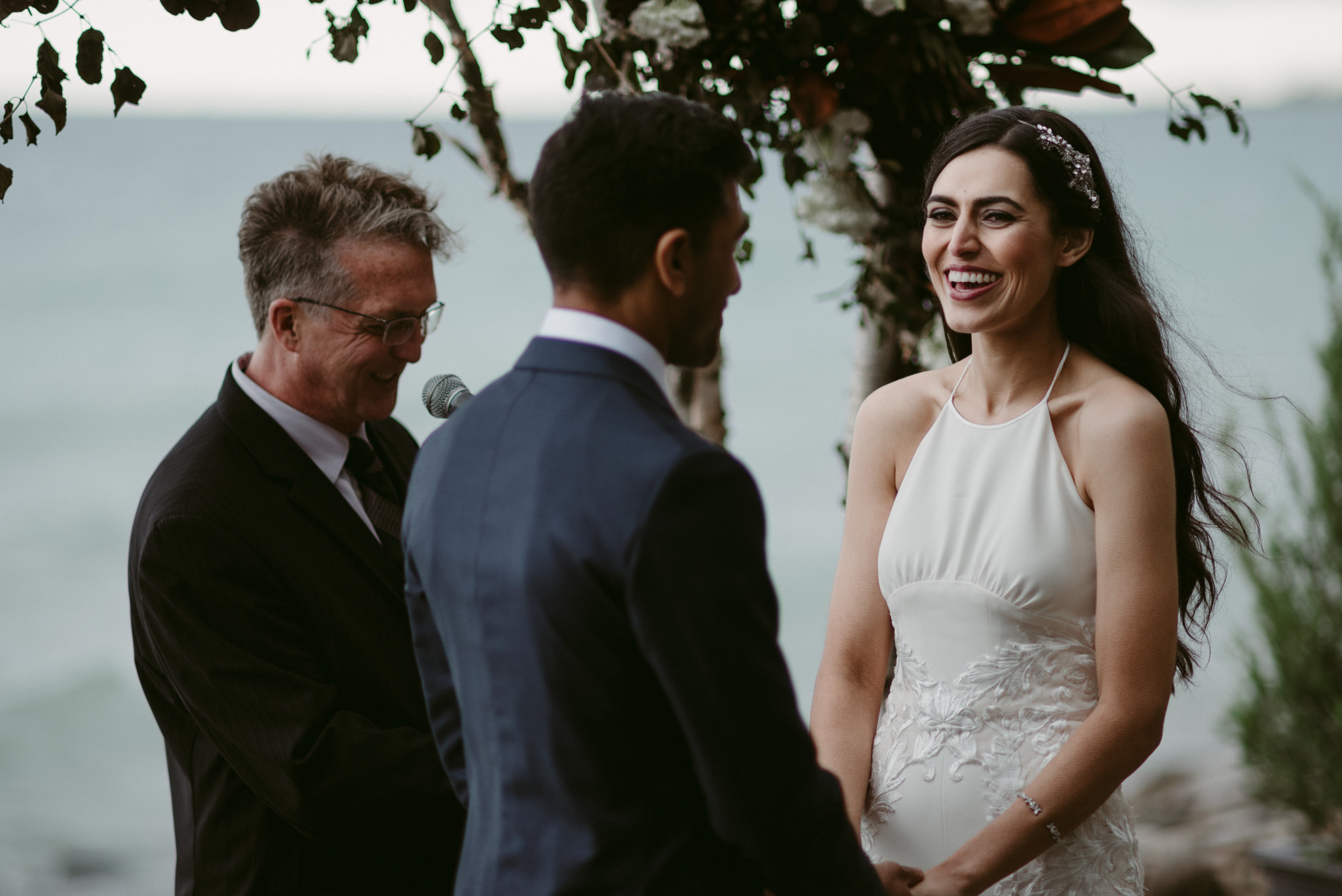 Bride smiling during outdoor wedding ceremony