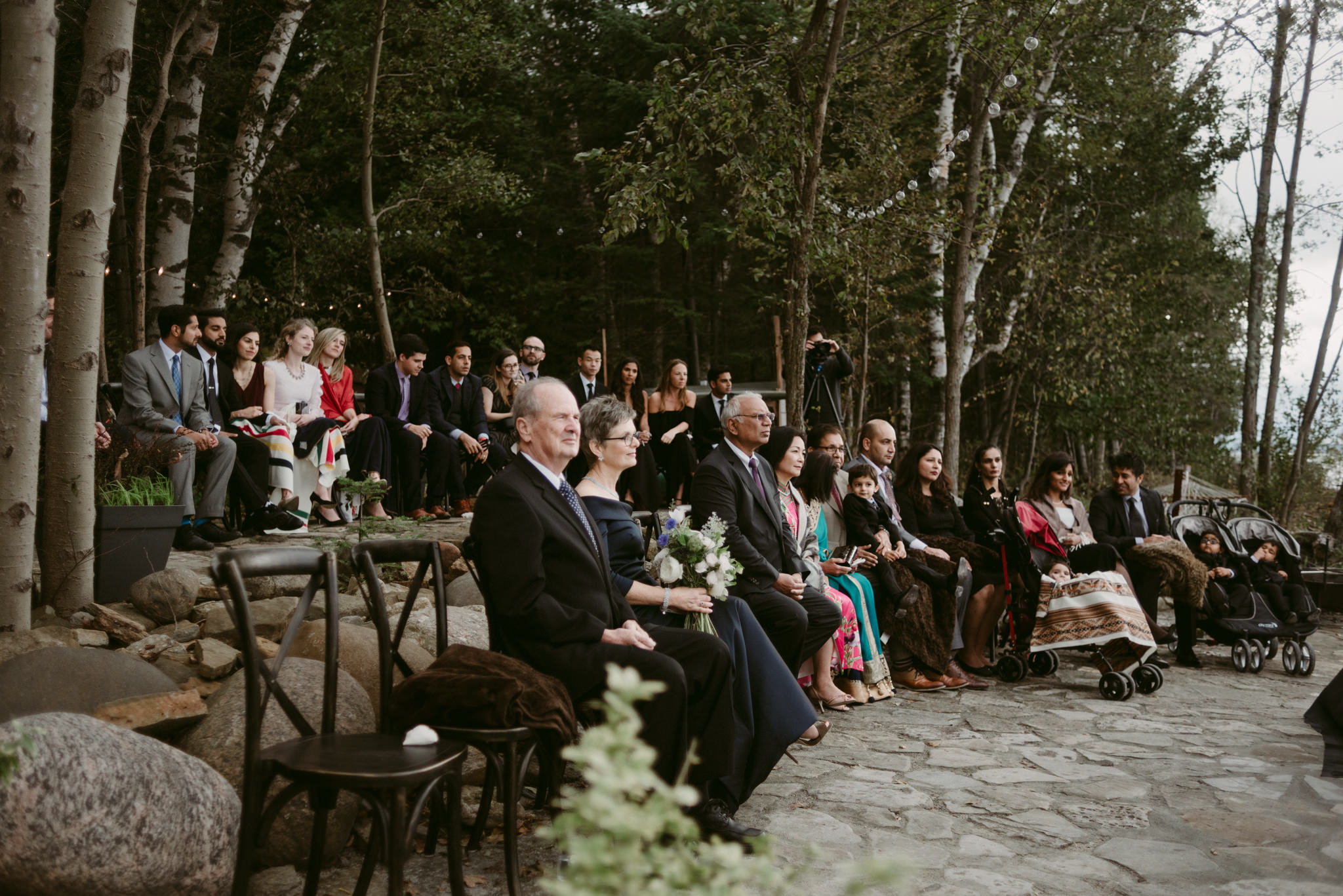 guests sitting outside during wedding ceremony