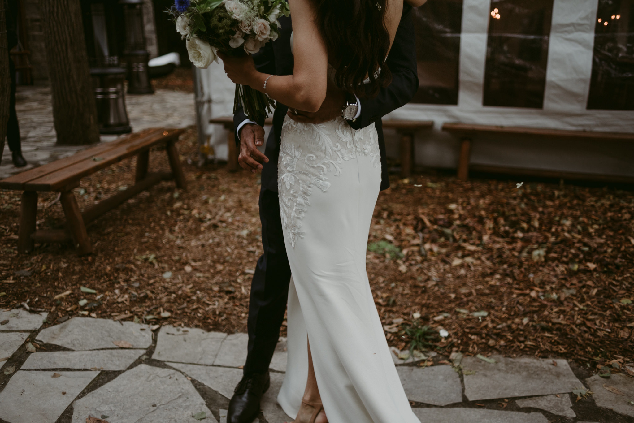 bride and groom hugging after wedding ceremony