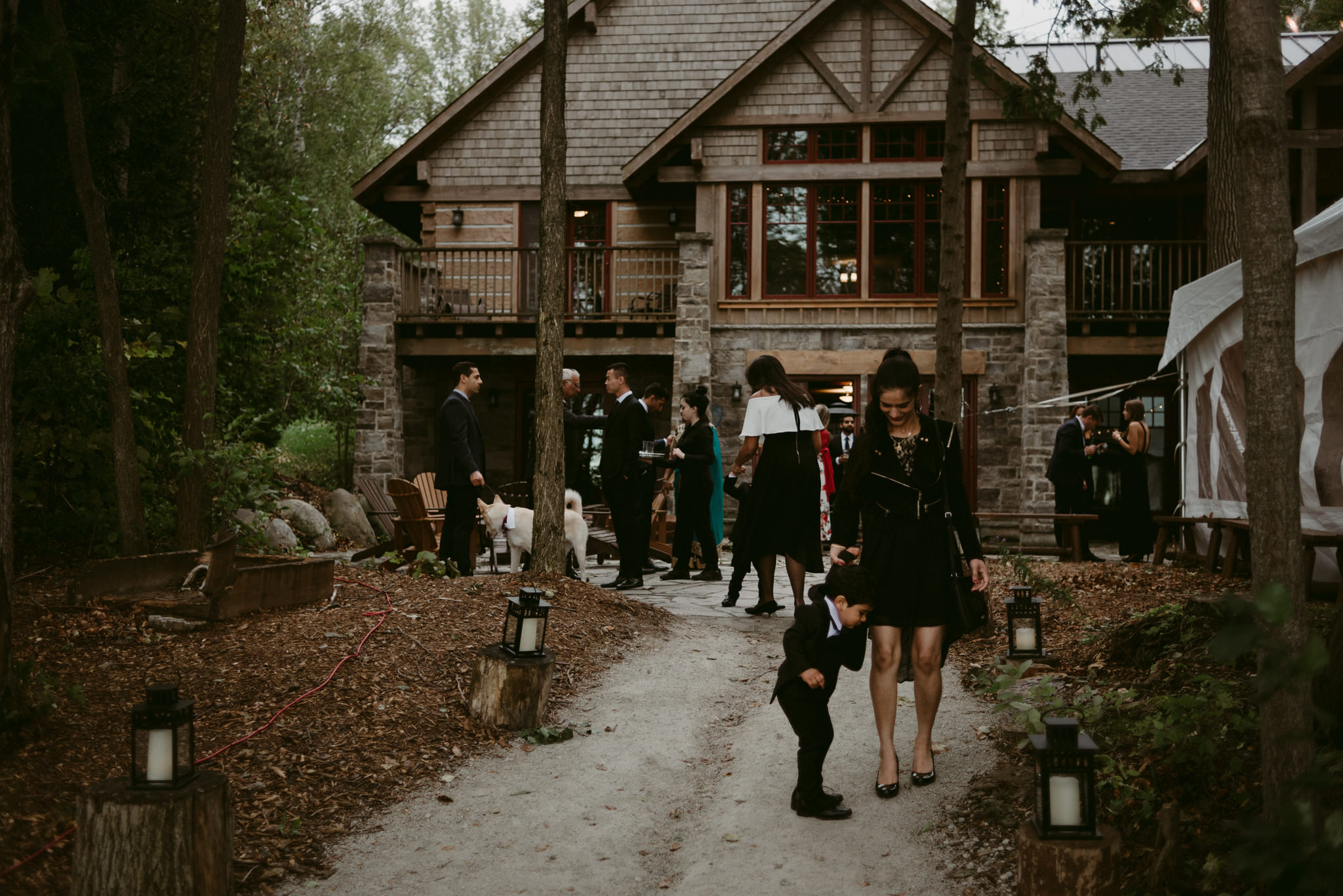 guests outside at cottage wedding