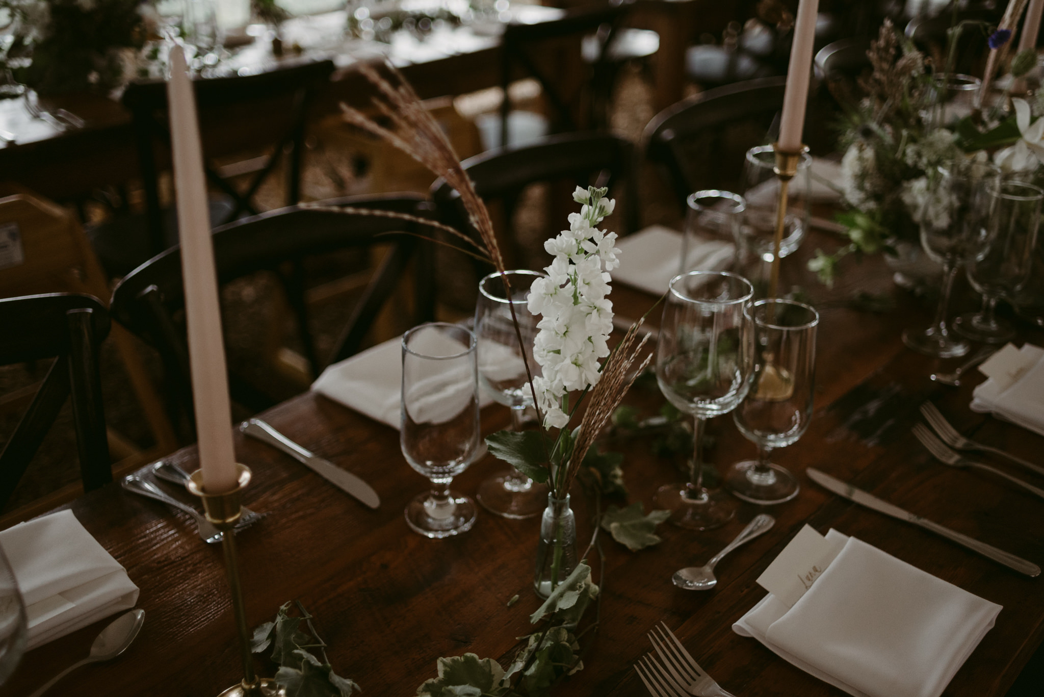 stems of wheat and vines for wedding table setup