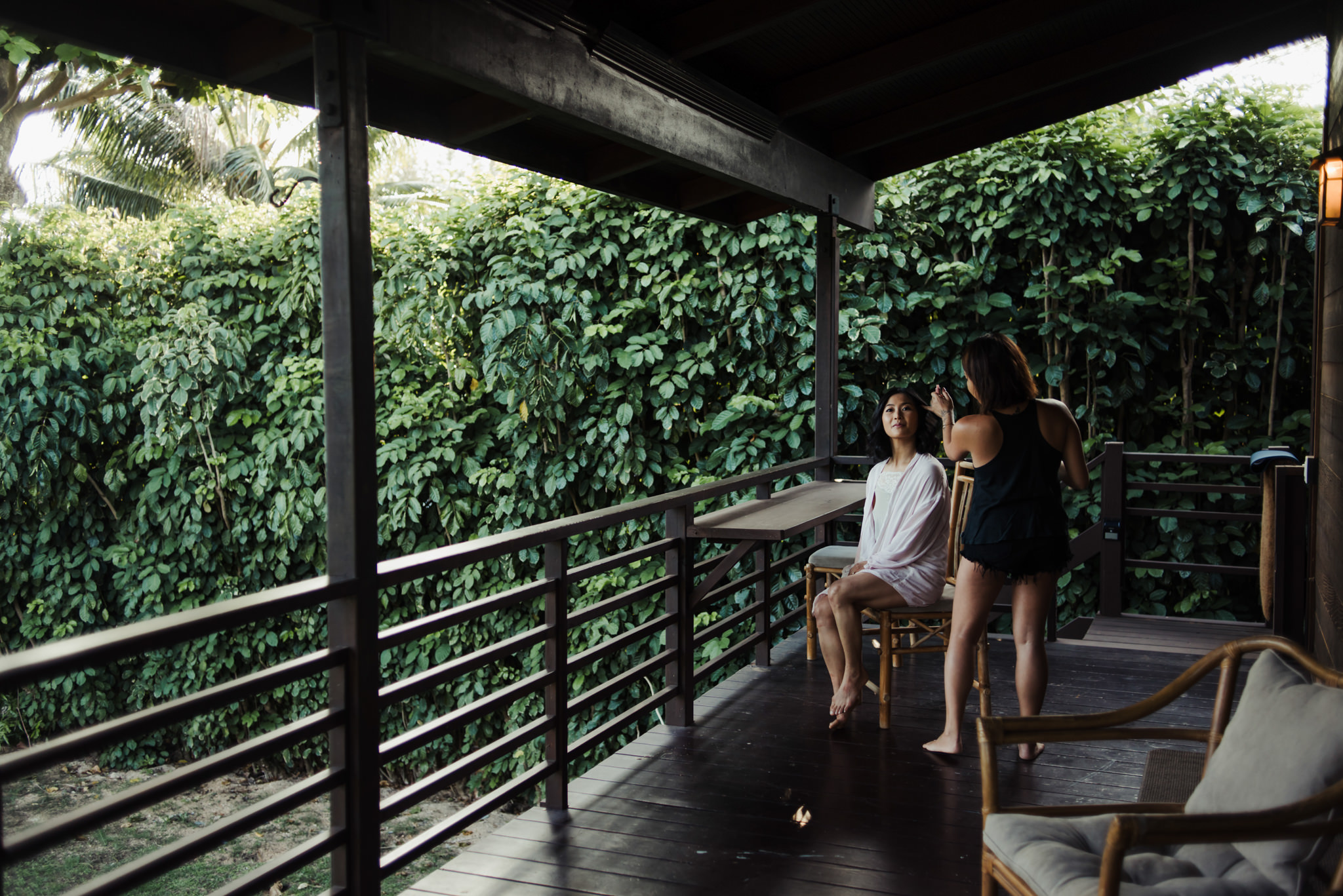 Bride getting ready on patio in tropical paradise Kauai