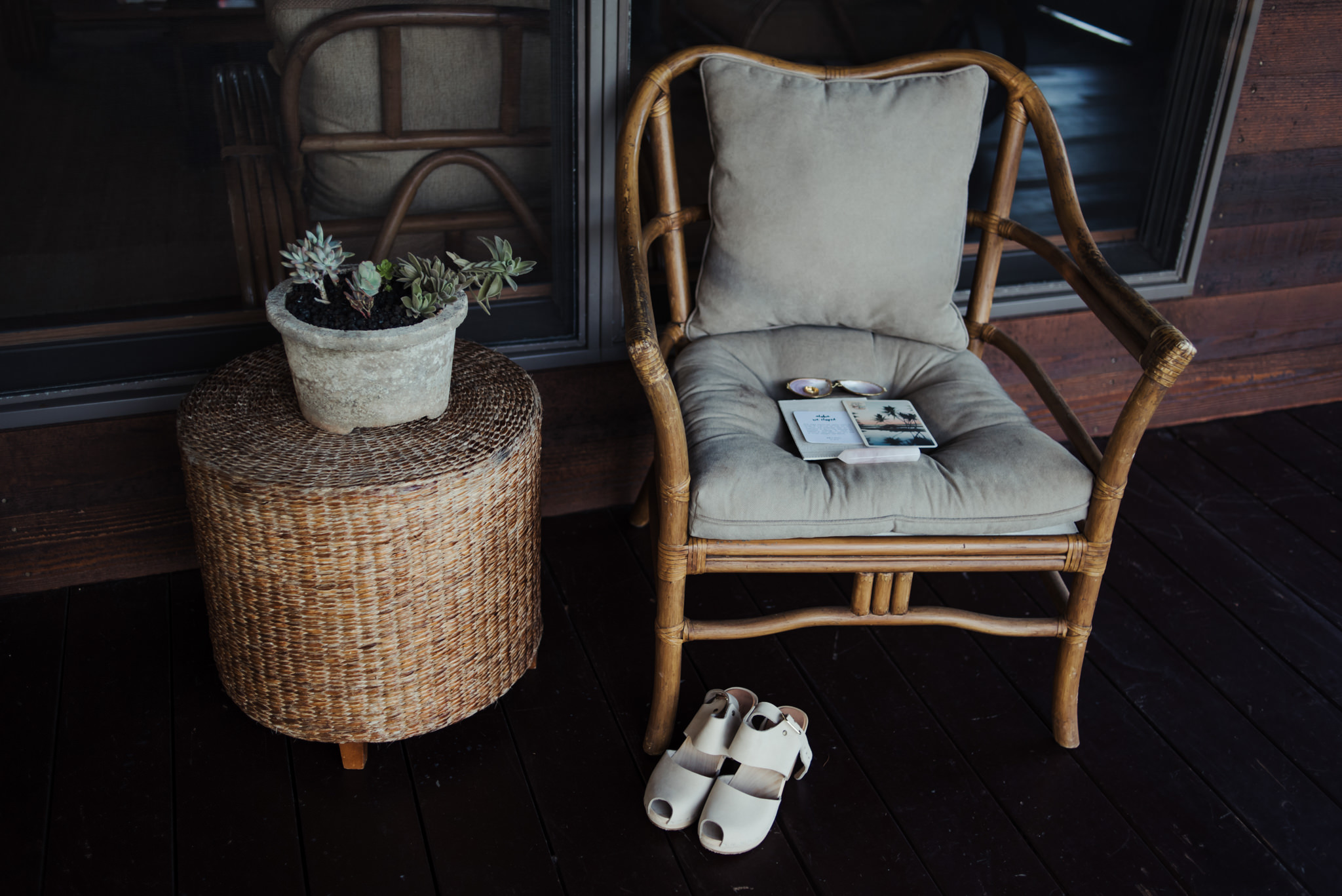 Wedding shoes and invitation on chair