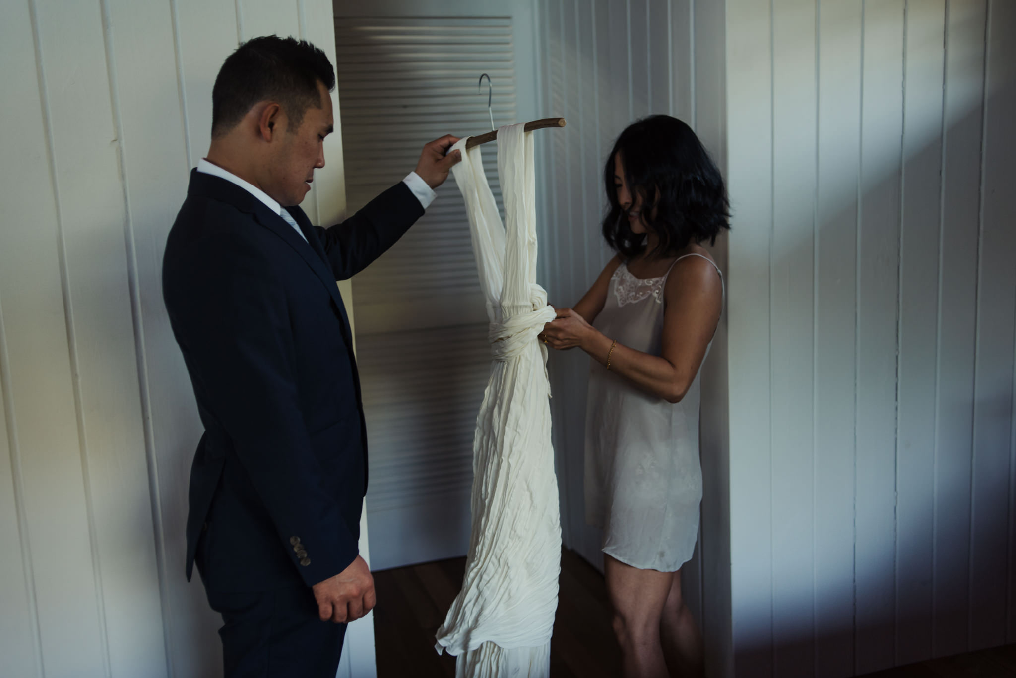 bride and groom getting ready