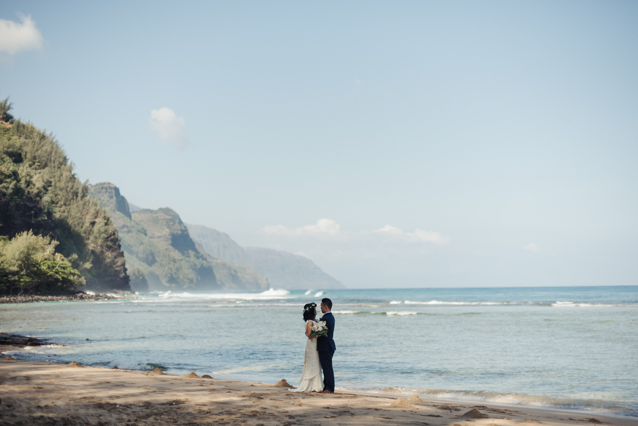 wedding portrait on ke'e beach with na pali coast in background