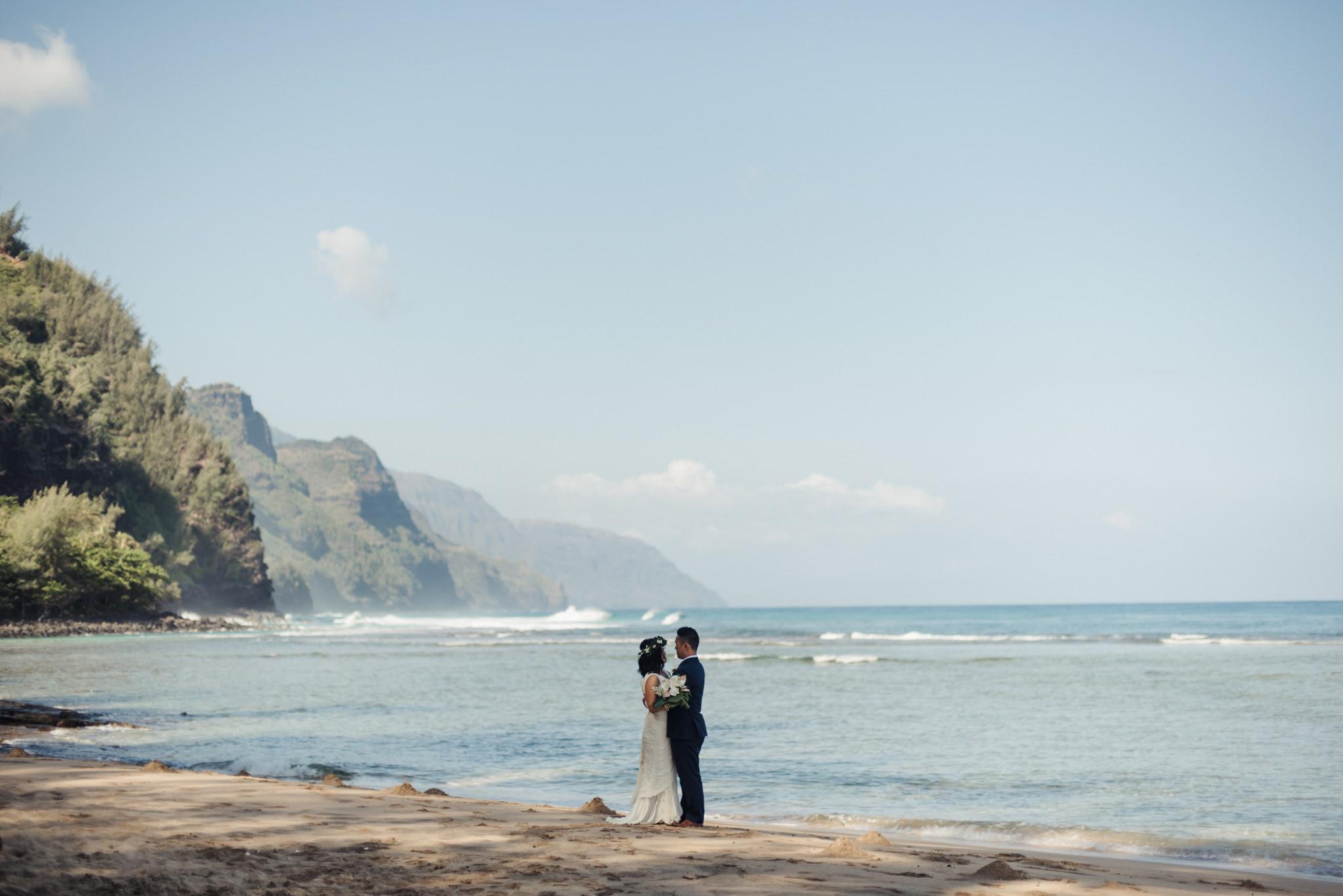 wedding portrait on ke'e beach with na pali coast in background