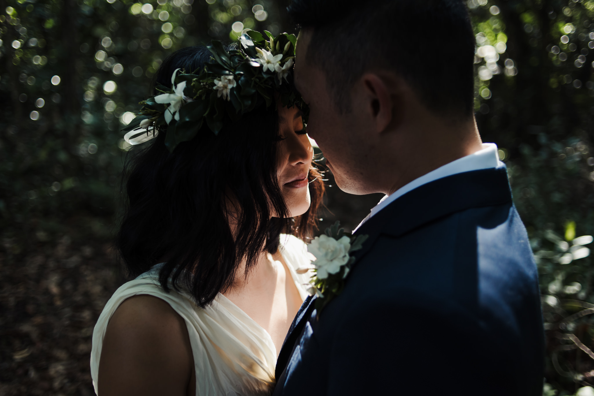 bride and groom walking in tropical forest