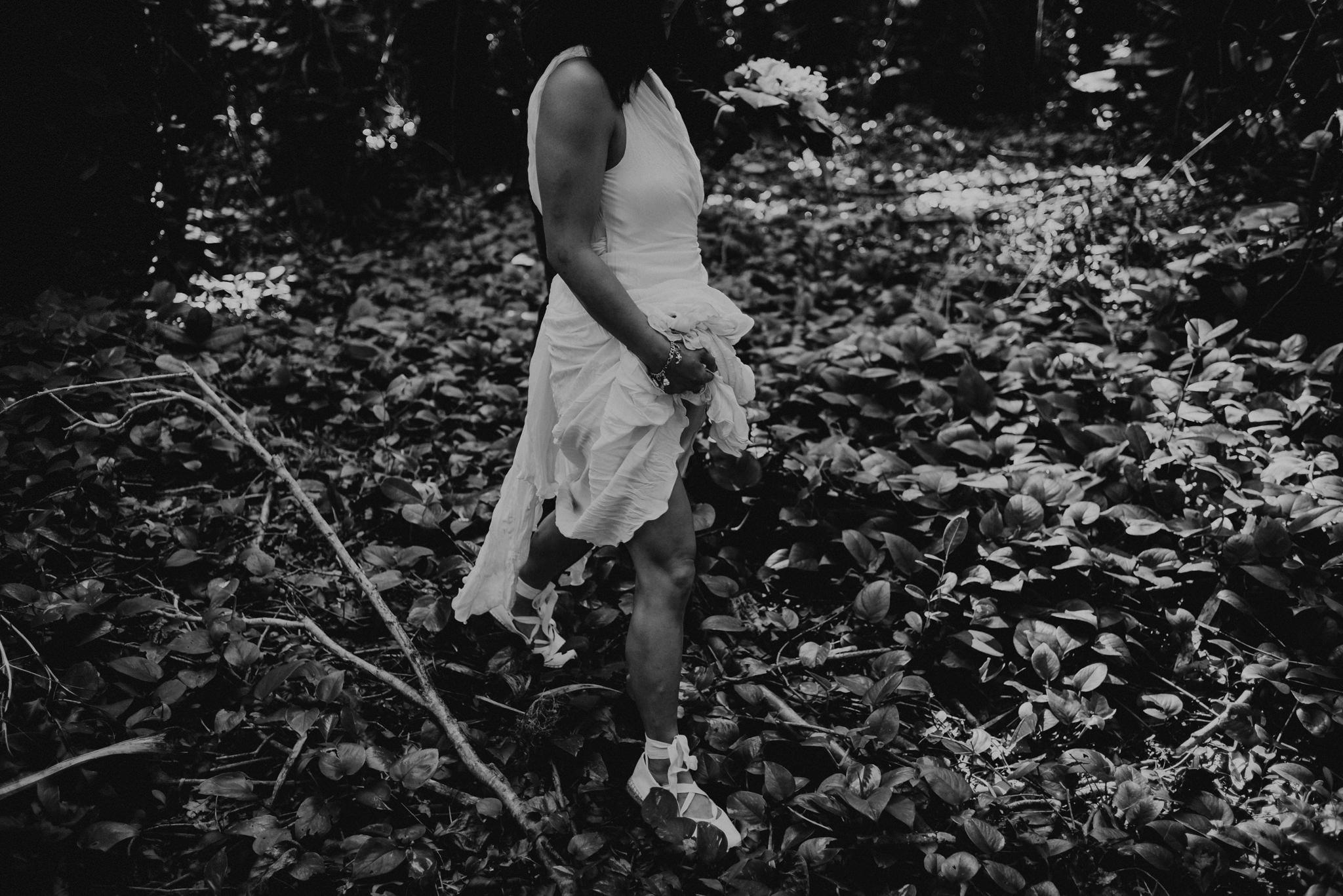 bride walking in forest