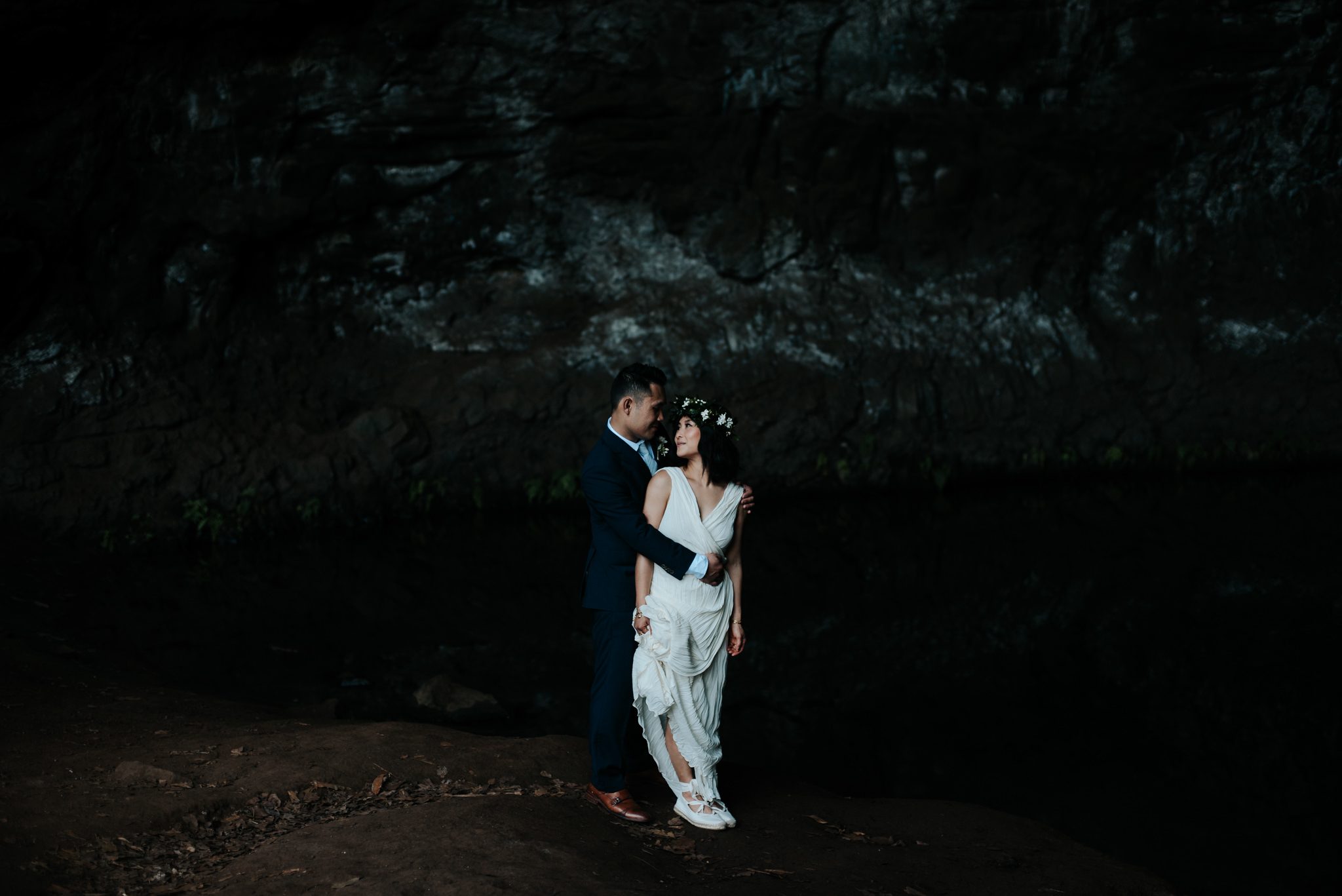 bride and groom in cave in kauai