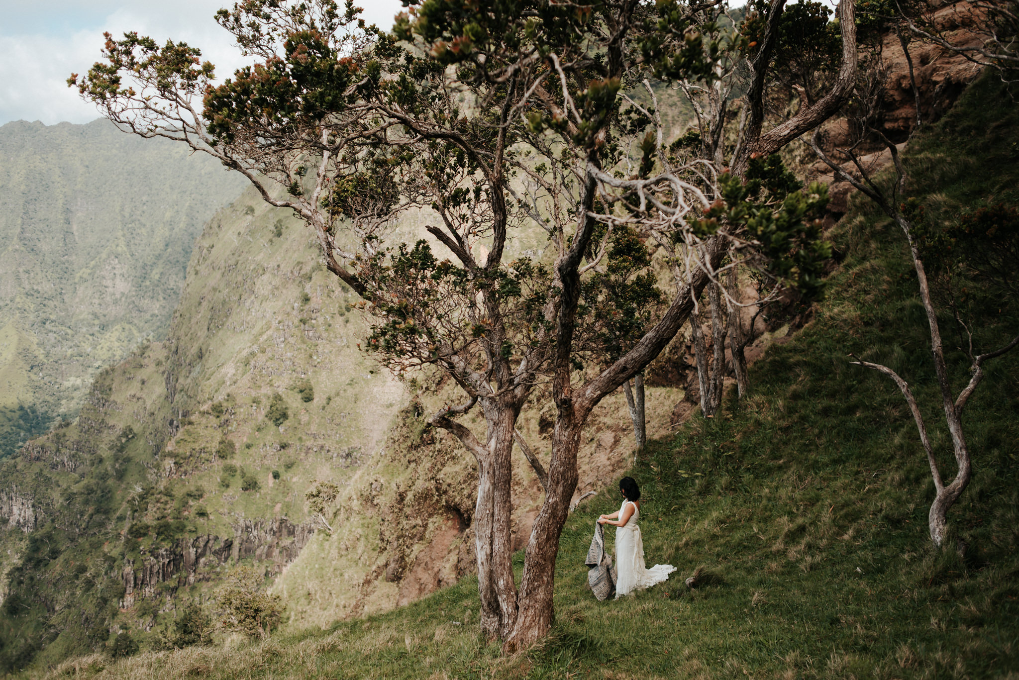 bride setting up picnic with view of Na pali Coast Kauai