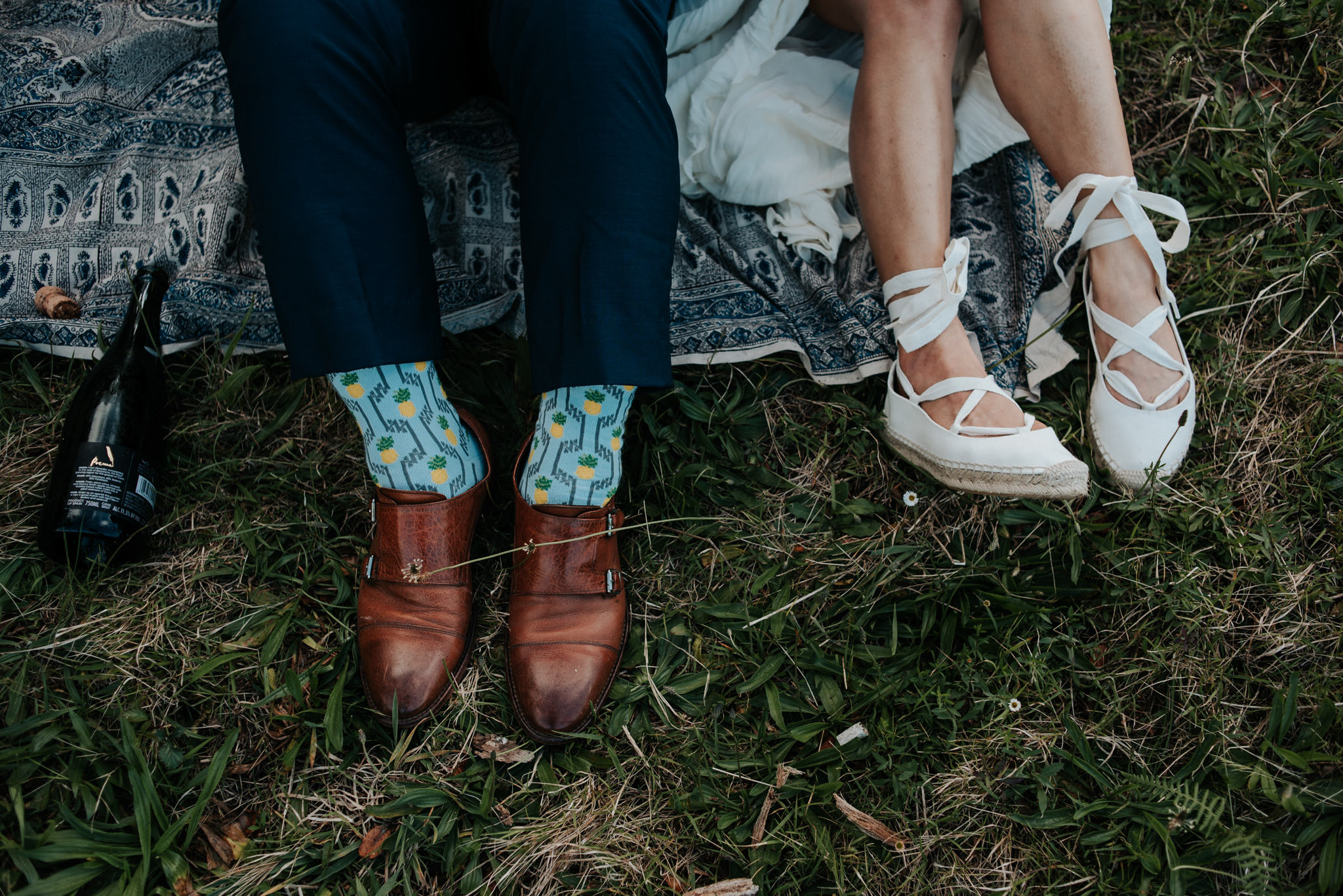 groom wearing pineapple socks