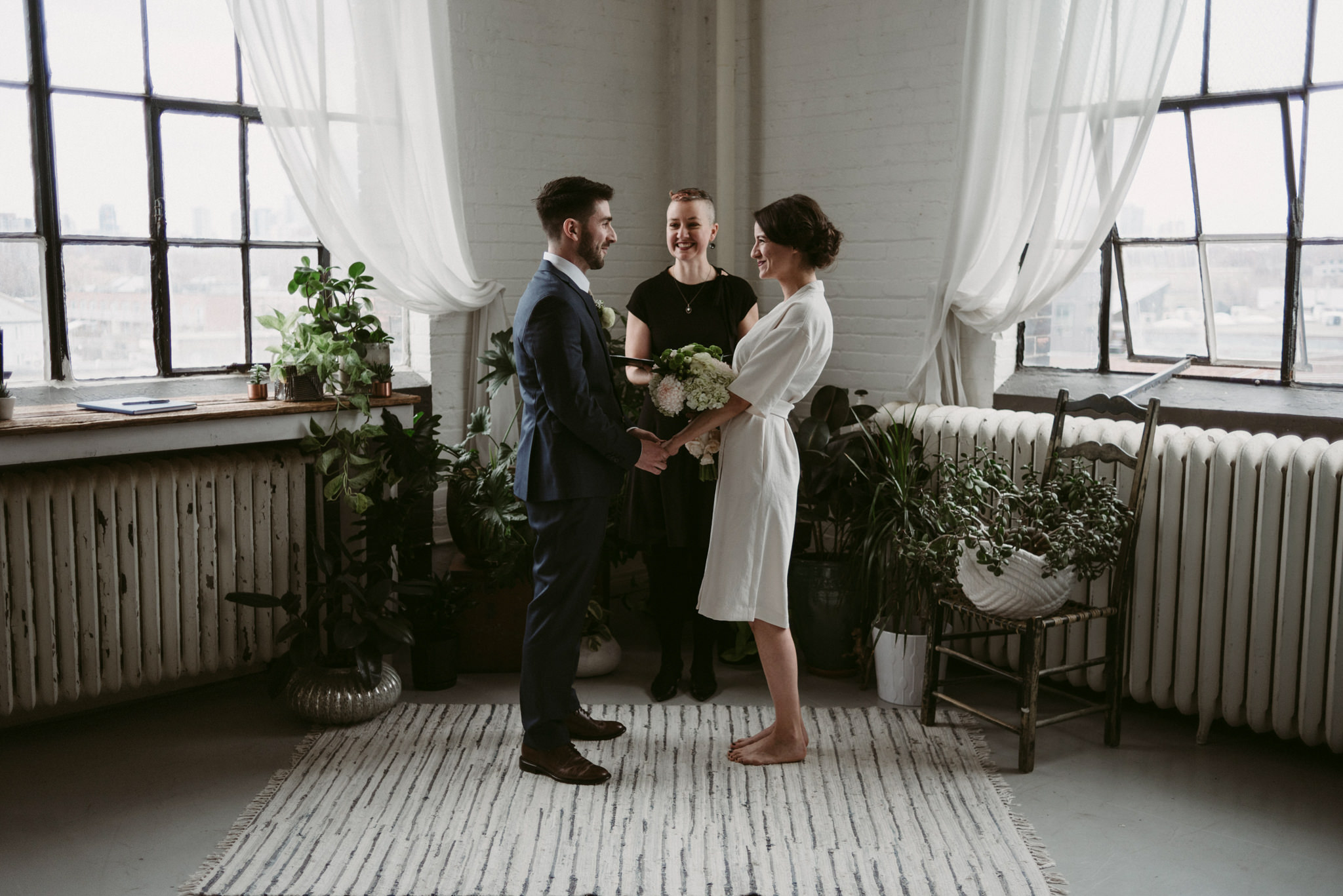 Bride and groom during Toronto loft elopement ceremony