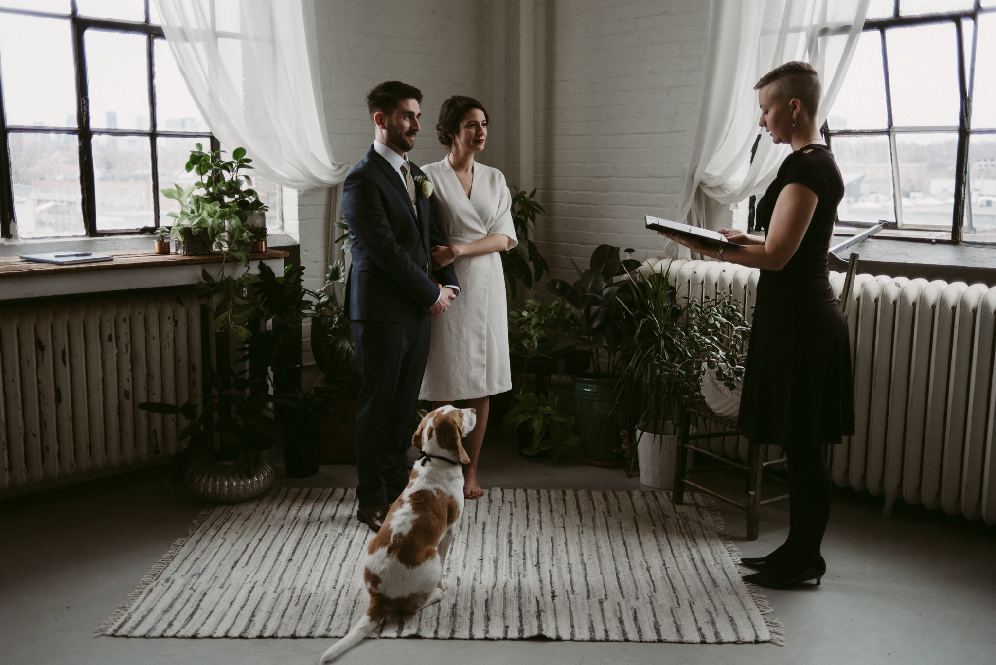 Dog watching during wedding ceremony in trendy Toronto loft