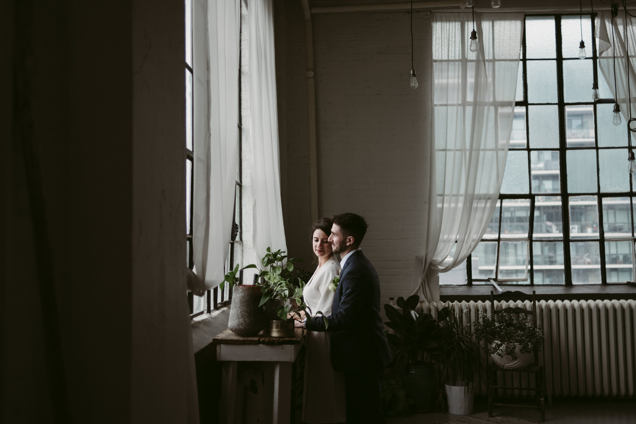 Bride and groom in trendy Toronto loft