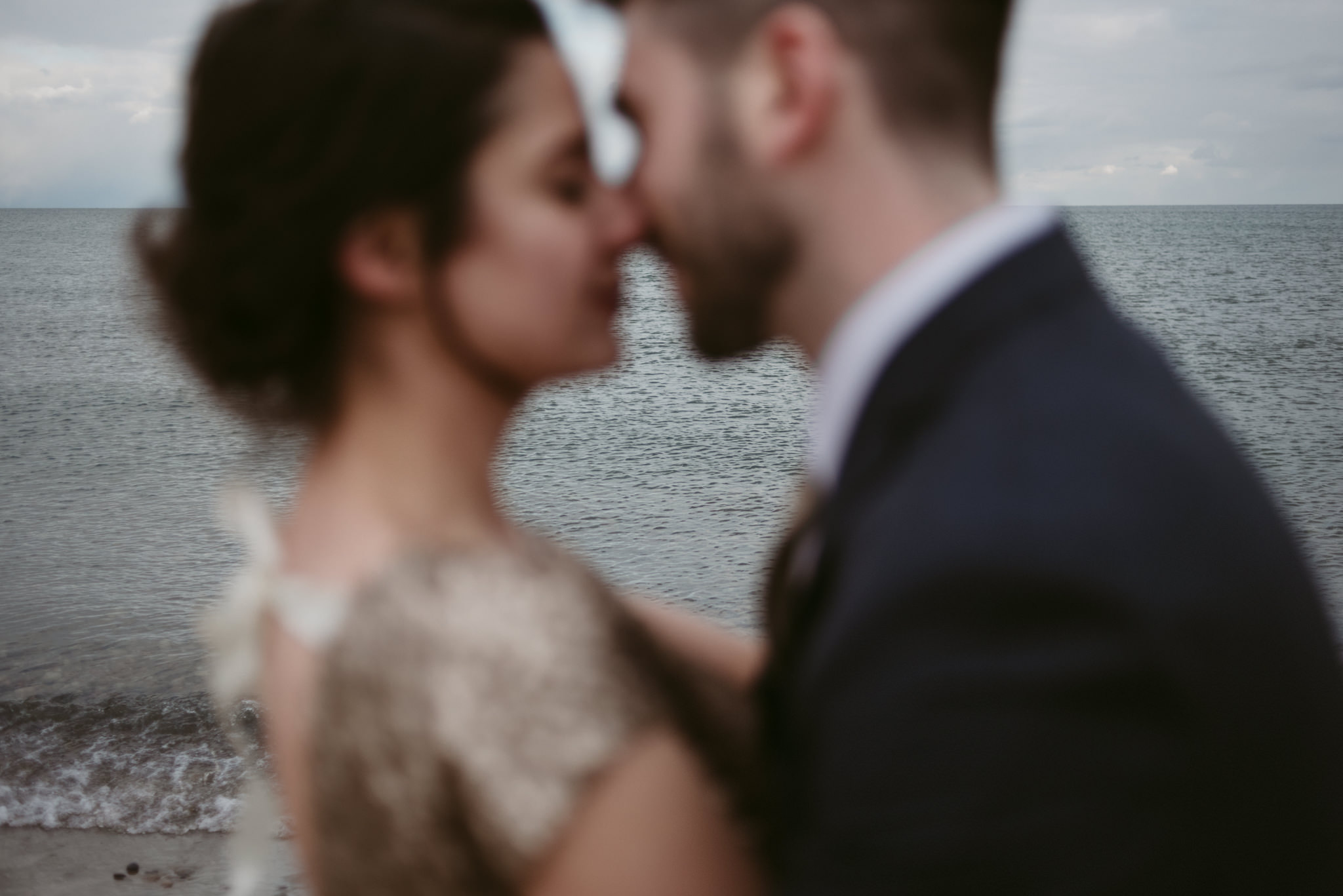 Water in focus with couple kissing