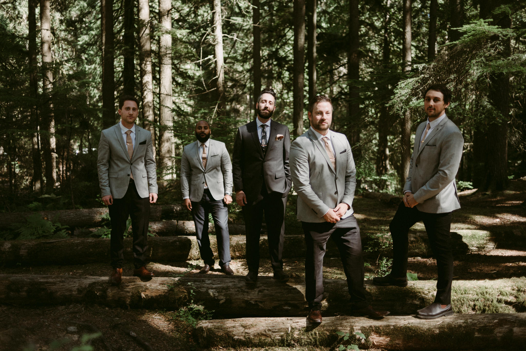 groom and groomsmen in forest