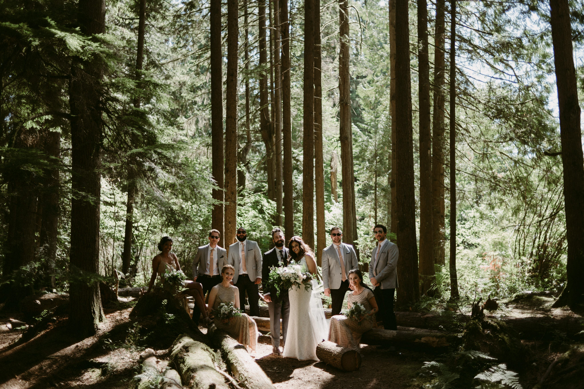 wedding party portrait in forest in vancouver